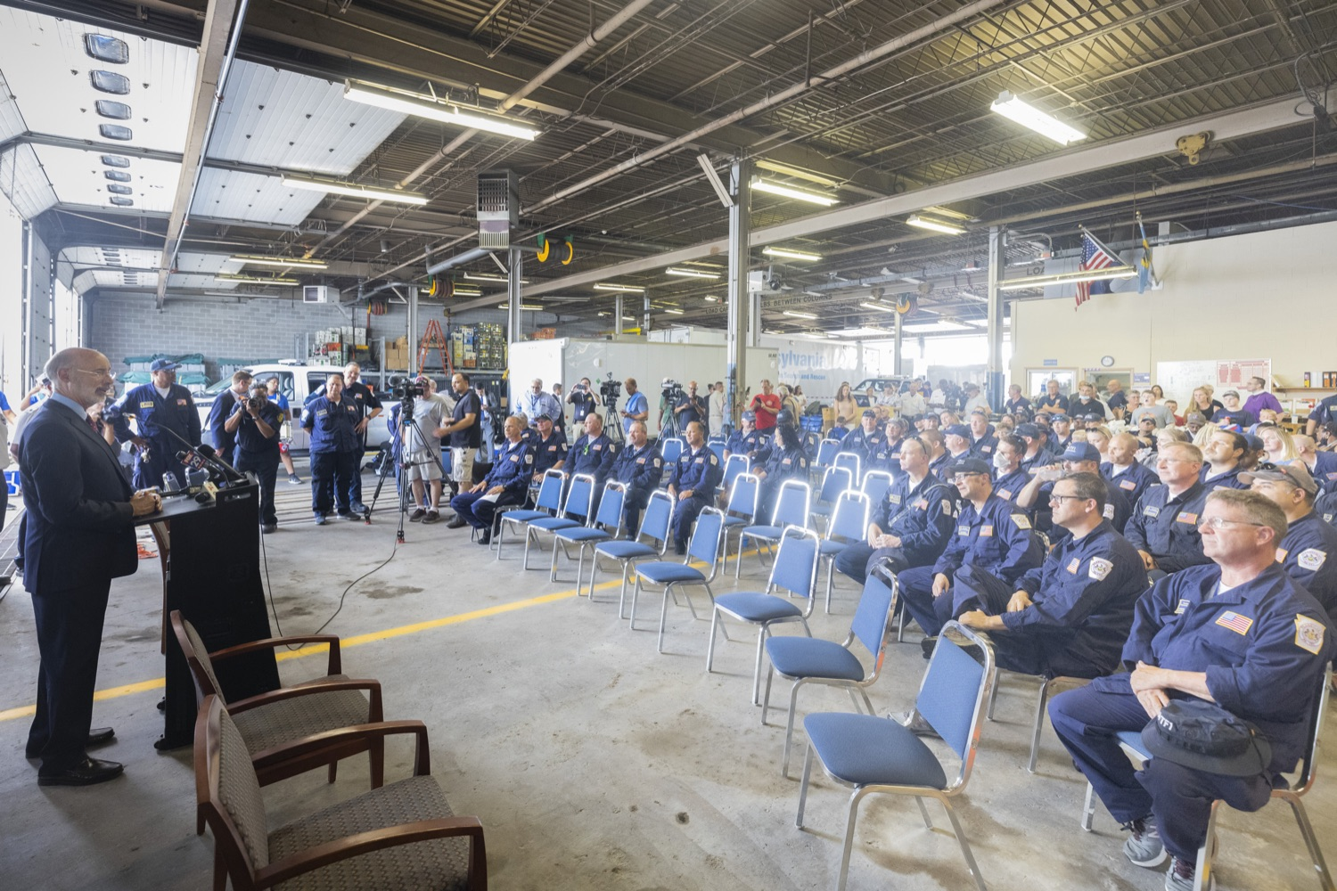 """<a href=""""https://filesource.wostreaming.net/commonwealthofpa/photo/18936_gov_taskforceone_dz_022.jpg"""" target=""""_blank"""">⇣Download Photo<br></a>Governor Tom Wolf speaking to returning Pennsylvania-Task Force 1. Members.Governor Tom Wolf thanked members of Pennsylvania-Task Force 1 (PA- TF1), who returned today to Philadelphia after spending two weeks assisting with search and rescue efforts at the site of the recent deadly building collapse in Surfside, Florida.  Philadelphia, Pa.  July 16, 2021"""