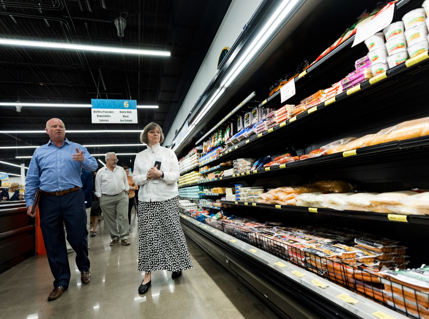 """<a href=""""https://filesource.wostreaming.net/commonwealthofpa/photo/18939_AGRIC_FL_Urban_Farms_NK_001.jpg"""" target=""""_blank"""">⇣Download Photo<br></a>Mike Mitchell, Treasures Markets chairman, gives a tour of the facility with Pennsylvania First Lady Frances Wolf, inside Treasures Markets in Lancaster on Monday, July 19, 2021. The Treasures of Hope Foundation and Treasures Markets were formed in February 2018 to bring back groceries to Lancaster City. Treasures of Hope is a 501C3 and Treasures Markets is an LLC social enterprise under Treasures of Hope. All profits from Treasures Markets go to Treasures of Hope which distributes them to other 501C3 organizations that feed the hungry and homeless."""