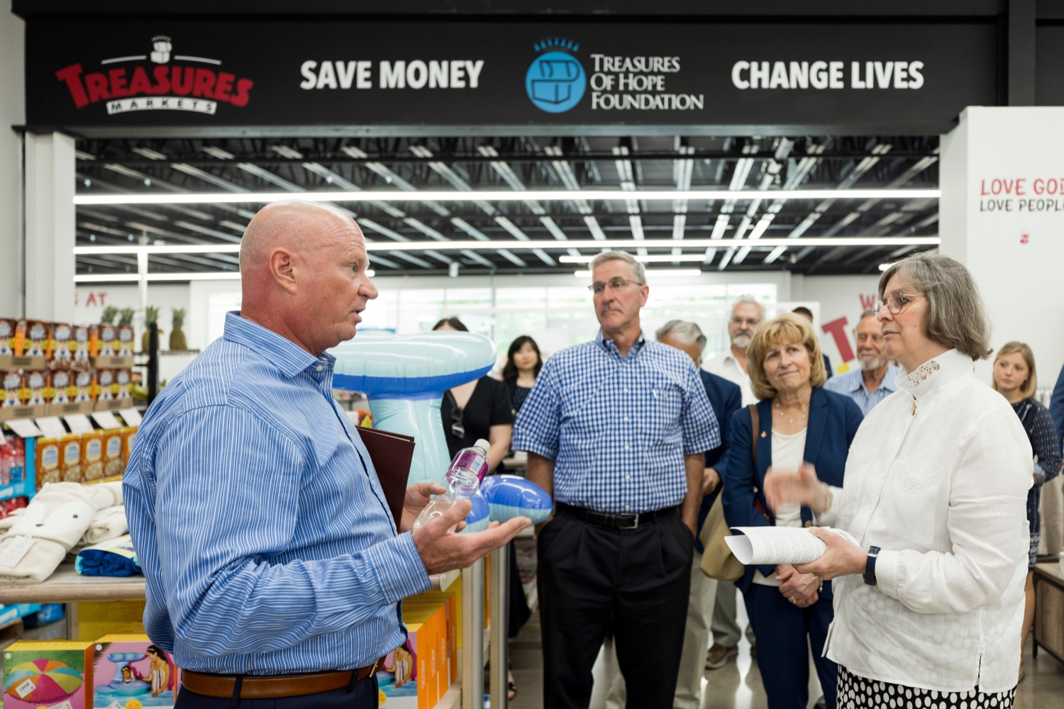 """<a href=""""https://filesource.wostreaming.net/commonwealthofpa/photo/18939_AGRIC_FL_Urban_Farms_NK_005.jpg"""" target=""""_blank"""">⇣Download Photo<br></a>Mike Mitchell, Treasures Markets chairman, left, speaks with PA Dept. of Agriculture Secretary Russell Redding, center, and Pennsylvania First Lady Frances Wolf, inside Treasures Markets in Lancaster on Monday, July 19, 2021. The Treasures of Hope Foundation and Treasures Markets were formed in February 2018 to bring back groceries to Lancaster City. Treasures of Hope is a 501C3 and Treasures Markets is an LLC social enterprise under Treasures of Hope. All profits from Treasures Markets go to Treasures of Hope which distributes them to other 501C3 organizations that feed the hungry and homeless."""