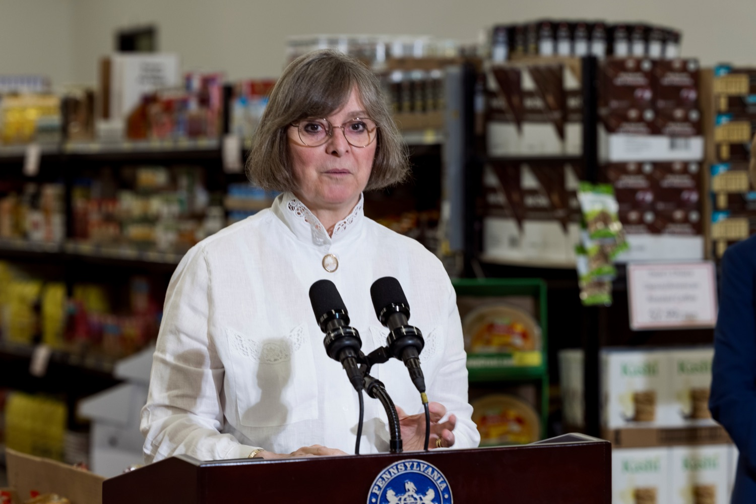 """<a href=""""https://filesource.wostreaming.net/commonwealthofpa/photo/18939_AGRIC_FL_Urban_Farms_NK_014.jpg"""" target=""""_blank"""">⇣Download Photo<br></a>Pennsylvania First Lady Frances Wolf speaks inside Treasures Markets in Lancaster on Monday, July 19, 2021. The Treasures of Hope Foundation and Treasures Markets were formed in February 2018 to bring back groceries to Lancaster City. Treasures of Hope is a 501C3 and Treasures Markets is an LLC social enterprise under Treasures of Hope. All profits from Treasures Markets go to Treasures of Hope which distributes them to other 501C3 organizations that feed the hungry and homeless."""