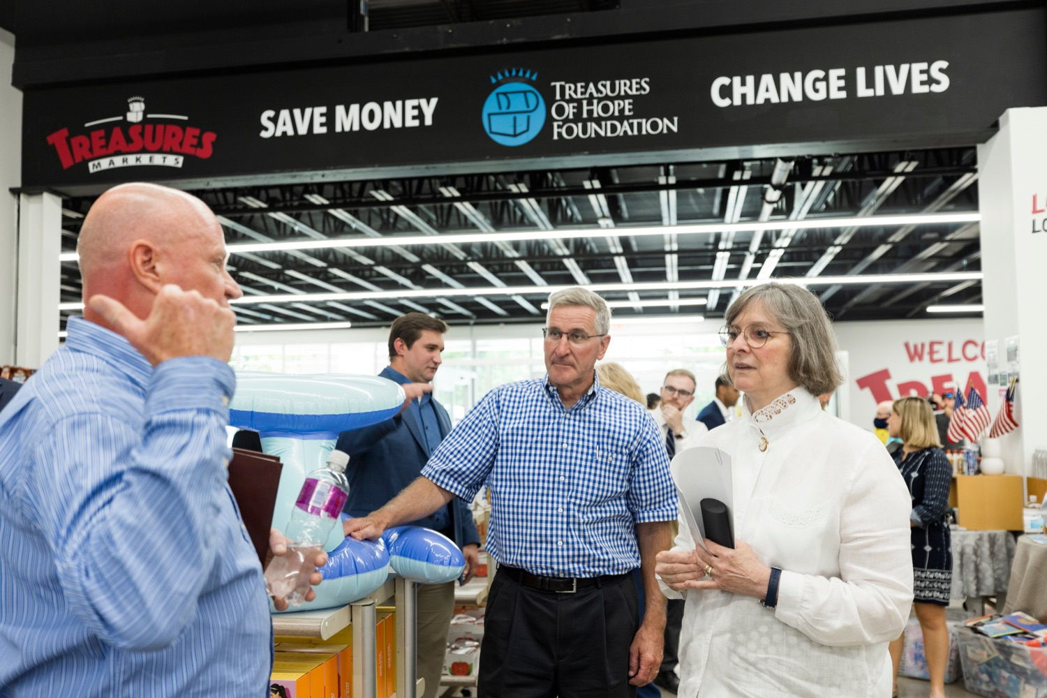 """<a href=""""https://filesource.wostreaming.net/commonwealthofpa/photo/18939_AGRIC_FL_Urban_Farms_NK_018.jpg"""" target=""""_blank"""">⇣Download Photo<br></a>Mike Mitchell, Treasures Markets chairman, left, speaks with PA Dept. of Agriculture Secretary Russell Redding, center, and Pennsylvania First Lady Frances Wolf, inside Treasures Markets in Lancaster on Monday, July 19, 2021. The Treasures of Hope Foundation and Treasures Markets were formed in February 2018 to bring back groceries to Lancaster City. Treasures of Hope is a 501C3 and Treasures Markets is an LLC social enterprise under Treasures of Hope. All profits from Treasures Markets go to Treasures of Hope which distributes them to other 501C3 organizations that feed the hungry and homeless."""