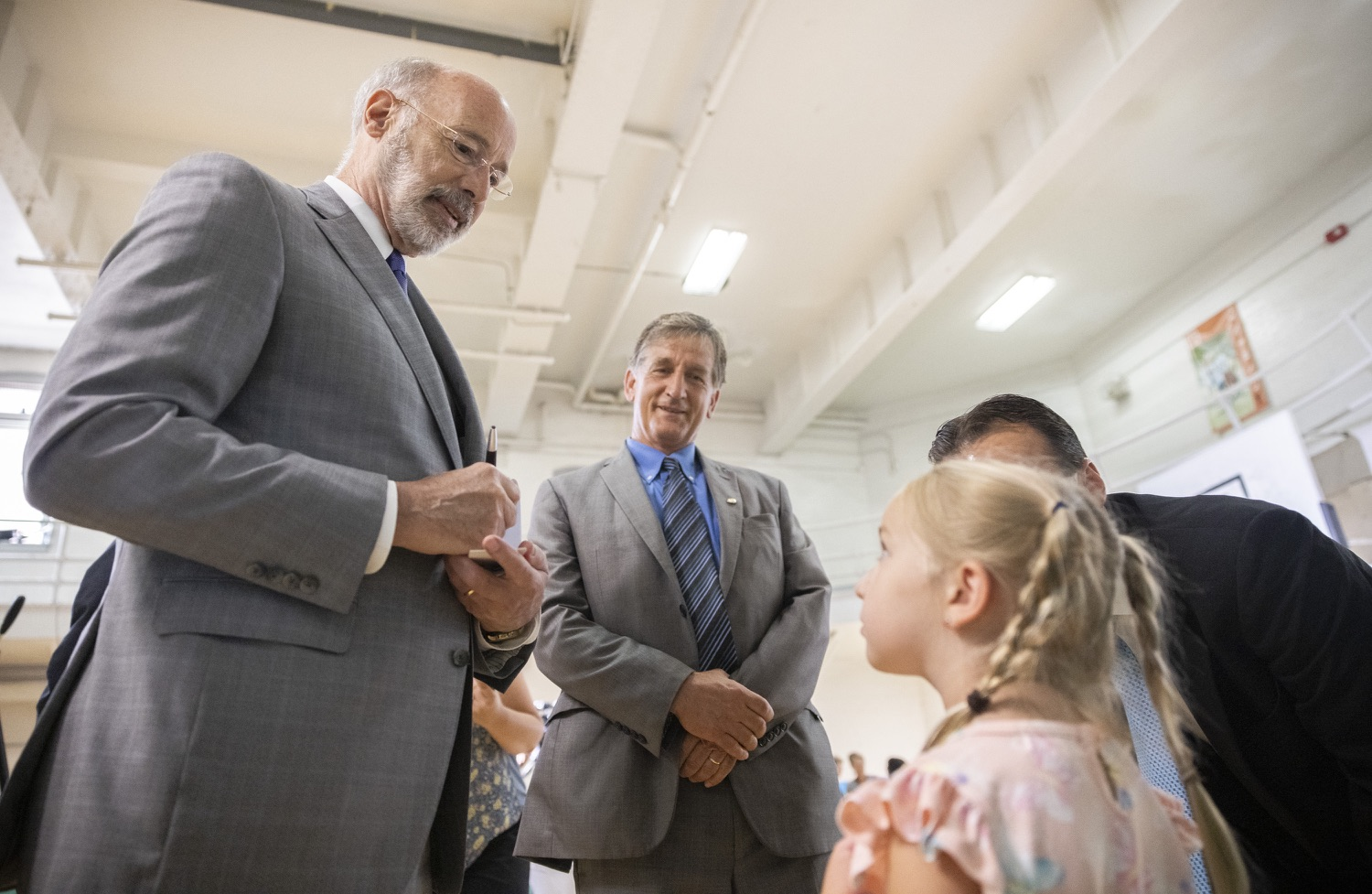 """<a href=""""https://filesource.wostreaming.net/commonwealthofpa/photo/18940_gov_childhooded_dz_017.jpg"""" target=""""_blank"""">⇣Download Photo<br></a>Pennsylvania Governor Tom Wolf signing an autograph.  Governor Tom Wolf today was joined by advocates and legislative members to celebrate the $30 million increase in early childhood education funding in the state budget at the YMCA in Reading. This new funding will allow an additional 3,270 children to enroll in the states high-quality early learning programs.  Reading, PA - July 19, 2021"""