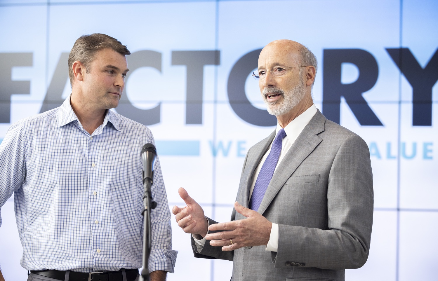 """<a href=""""https://filesource.wostreaming.net/commonwealthofpa/photo/18941_gov_economicDevelopment_dz_001.jpg"""" target=""""_blank"""">⇣Download Photo<br></a>Pennsylvania Governor Tom Wolf and Keith Caldwell, Partner  Factory LLC speaking with the press.  Governor Tom Wolf today visited Factory LLC in Bethlehem to tour the facility and highlight the importance of investing in Pennsylvanias start-up companies. During the visit, he met with companies affiliated with Factory, including Stuffed Puffs®, which received a $1 million funding proposal from the commonwealth in 2019 to expand its manufacturing operations and create jobs, Mikeys®, Pipcorn®, Honey Stinger®, and ROAR® Organic. Bethlehem, PA  July 19, 2021"""