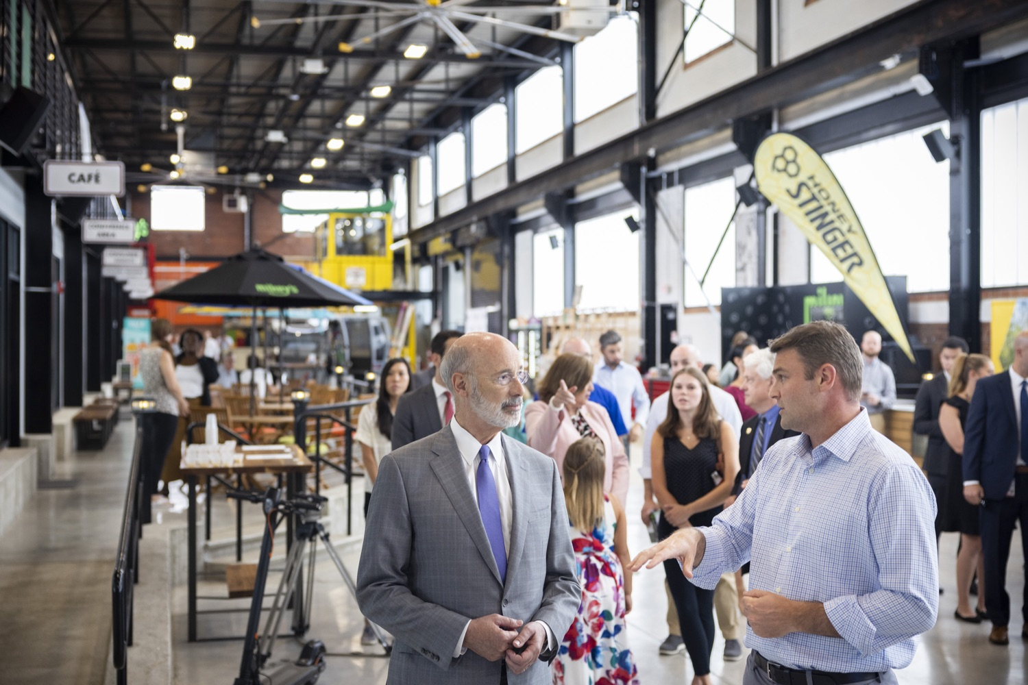 """<a href=""""https://filesource.wostreaming.net/commonwealthofpa/photo/18941_gov_economicDevelopment_dz_002.jpg"""" target=""""_blank"""">⇣Download Photo<br></a>Keith Caldwell, Partner  Factory LLC giving Pennsylvania Governor Tom Wolf a tour of Factory LLC.  Governor Tom Wolf today visited Factory LLC in Bethlehem to tour the facility and highlight the importance of investing in Pennsylvanias start-up companies. During the visit, he met with companies affiliated with Factory, including Stuffed Puffs®, which received a $1 million funding proposal from the commonwealth in 2019 to expand its manufacturing operations and create jobs, Mikeys®, Pipcorn®, Honey Stinger®, and ROAR® Organic. Bethlehem, PA  July 19, 2021"""