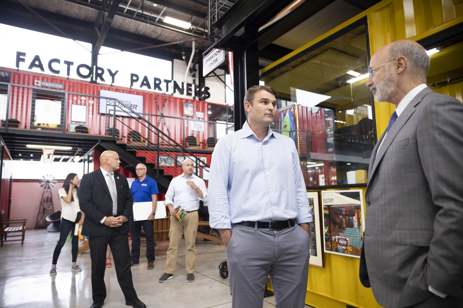 """<a href=""""https://filesource.wostreaming.net/commonwealthofpa/photo/18941_gov_economicDevelopment_dz_004.jpg"""" target=""""_blank"""">⇣Download Photo<br></a>Keith Caldwell, Partner  Factory LLC giving Pennsylvania Governor Tom Wolf a tour of Factory LLC.  Governor Tom Wolf today visited Factory LLC in Bethlehem to tour the facility and highlight the importance of investing in Pennsylvanias start-up companies. During the visit, he met with companies affiliated with Factory, including Stuffed Puffs®, which received a $1 million funding proposal from the commonwealth in 2019 to expand its manufacturing operations and create jobs, Mikeys®, Pipcorn®, Honey Stinger®, and ROAR® Organic. Bethlehem, PA  July 19, 2021"""