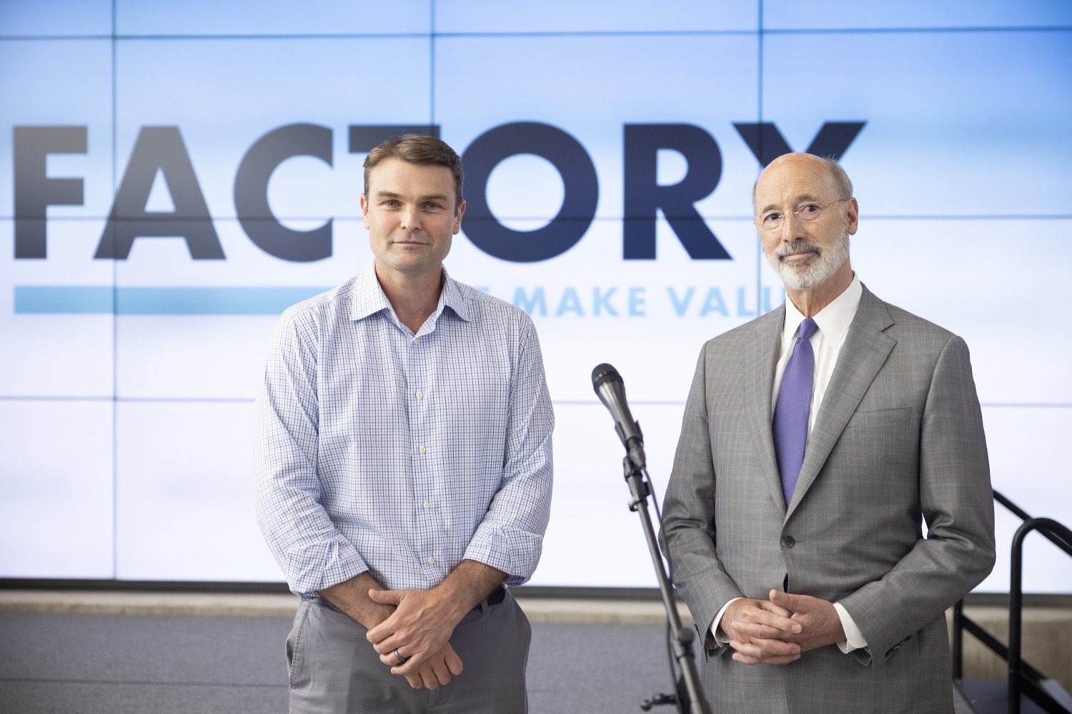 """<a href=""""https://filesource.wostreaming.net/commonwealthofpa/photo/18941_gov_economicDevelopment_dz_006.jpg"""" target=""""_blank"""">⇣Download Photo<br></a>Pennsylvania Governor Tom Wolf and Keith Caldwell, Partner  Factory LLC speaking with the press.  Governor Tom Wolf today visited Factory LLC in Bethlehem to tour the facility and highlight the importance of investing in Pennsylvanias start-up companies. During the visit, he met with companies affiliated with Factory, including Stuffed Puffs®, which received a $1 million funding proposal from the commonwealth in 2019 to expand its manufacturing operations and create jobs, Mikeys®, Pipcorn®, Honey Stinger®, and ROAR® Organic. Bethlehem, PA  July 19, 2021"""