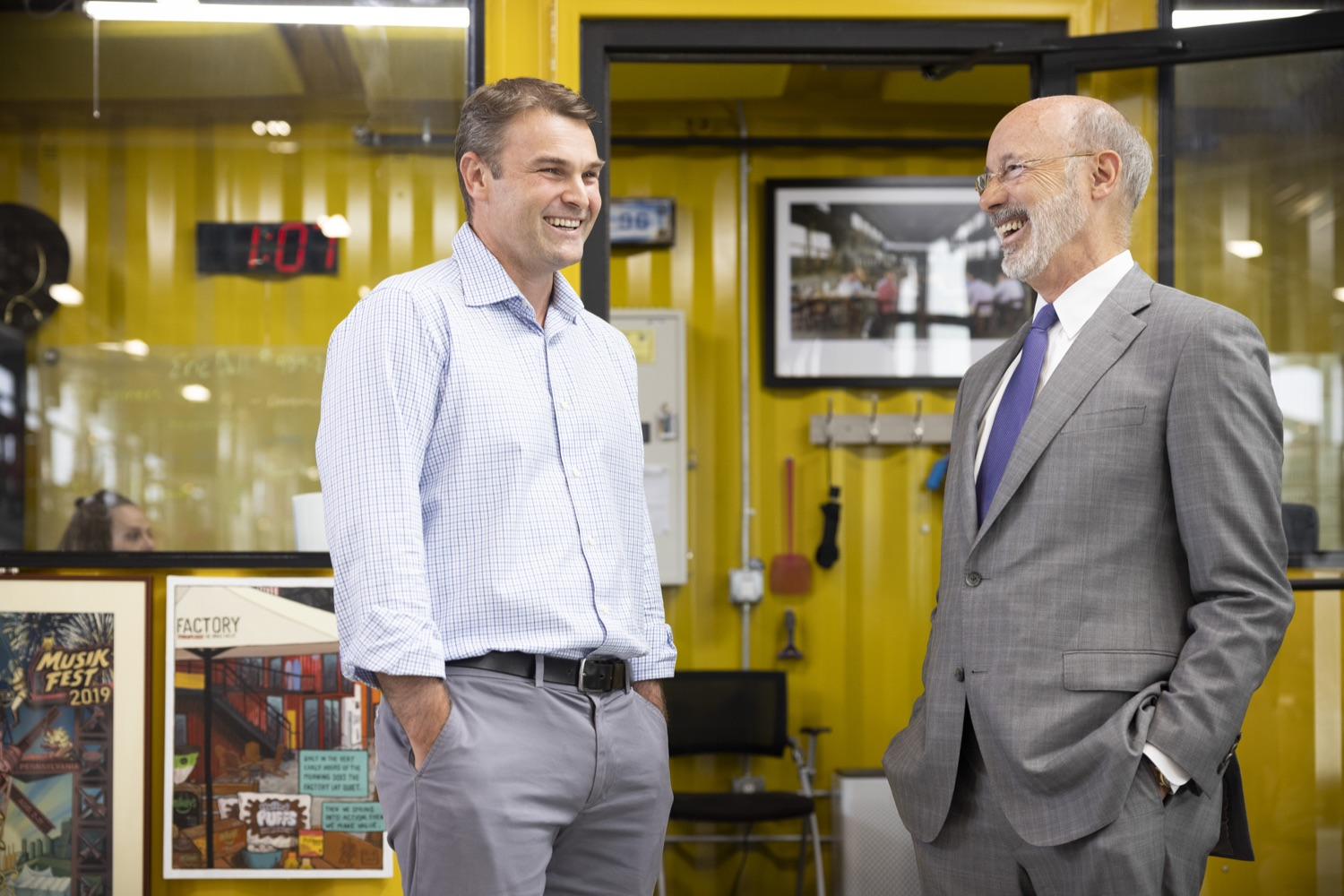 """<a href=""""https://filesource.wostreaming.net/commonwealthofpa/photo/18941_gov_economicDevelopment_dz_007.jpg"""" target=""""_blank"""">⇣Download Photo<br></a>Keith Caldwell, Partner  Factory LLC giving Pennsylvania Governor Tom Wolf a tour of Factory LLC.  Governor Tom Wolf today visited Factory LLC in Bethlehem to tour the facility and highlight the importance of investing in Pennsylvanias start-up companies. During the visit, he met with companies affiliated with Factory, including Stuffed Puffs®, which received a $1 million funding proposal from the commonwealth in 2019 to expand its manufacturing operations and create jobs, Mikeys®, Pipcorn®, Honey Stinger®, and ROAR® Organic. Bethlehem, PA  July 19, 2021"""