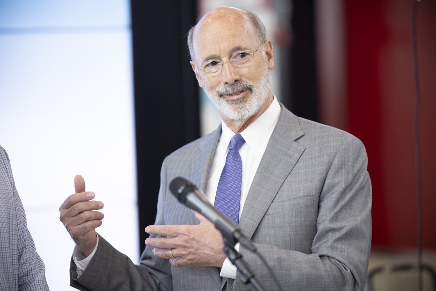 """<a href=""""https://filesource.wostreaming.net/commonwealthofpa/photo/18941_gov_economicDevelopment_dz_012.jpg"""" target=""""_blank"""">⇣Download Photo<br></a>Pennsylvania Governor Tom Wolf speaking with the press.  Governor Tom Wolf today visited Factory LLC in Bethlehem to tour the facility and highlight the importance of investing in Pennsylvanias start-up companies. During the visit, he met with companies affiliated with Factory, including Stuffed Puffs®, which received a $1 million funding proposal from the commonwealth in 2019 to expand its manufacturing operations and create jobs, Mikeys®, Pipcorn®, Honey Stinger®, and ROAR® Organic. Bethlehem, PA  July 19, 2021"""