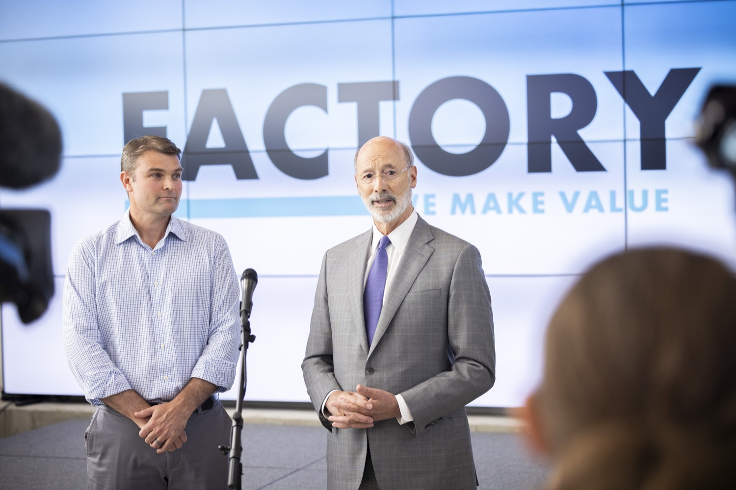 """<a href=""""https://filesource.wostreaming.net/commonwealthofpa/photo/18941_gov_economicDevelopment_dz_014.jpg"""" target=""""_blank"""">⇣Download Photo<br></a>Pennsylvania Governor Tom Wolf and Keith Caldwell, Partner  Factory LLC speaking with the press.  Governor Tom Wolf today visited Factory LLC in Bethlehem to tour the facility and highlight the importance of investing in Pennsylvanias start-up companies. During the visit, he met with companies affiliated with Factory, including Stuffed Puffs®, which received a $1 million funding proposal from the commonwealth in 2019 to expand its manufacturing operations and create jobs, Mikeys®, Pipcorn®, Honey Stinger®, and ROAR® Organic. Bethlehem, PA  July 19, 2021"""