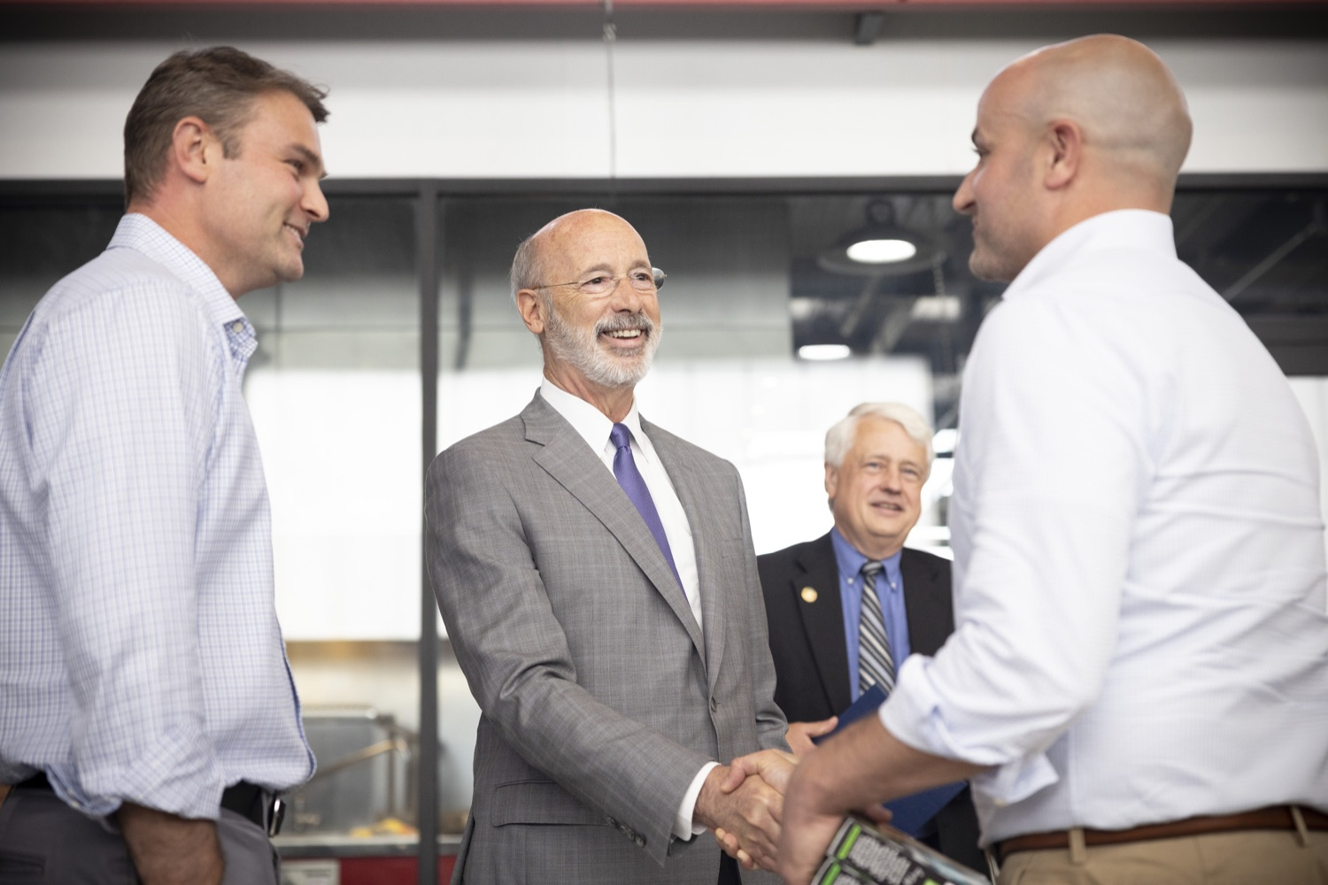 """<a href=""""https://filesource.wostreaming.net/commonwealthofpa/photo/18941_gov_economicDevelopment_dz_017.jpg"""" target=""""_blank"""">⇣Download Photo<br></a>Joey Piazza, CEO  Mikeys greeting Pennsylvania Governor Tom Wolf.  Governor Tom Wolf today visited Factory LLC in Bethlehem to tour the facility and highlight the importance of investing in Pennsylvanias start-up companies. During the visit, he met with companies affiliated with Factory, including Stuffed Puffs®, which received a $1 million funding proposal from the commonwealth in 2019 to expand its manufacturing operations and create jobs, Mikeys®, Pipcorn®, Honey Stinger®, and ROAR® Organic. Bethlehem, PA  July 19, 2021"""