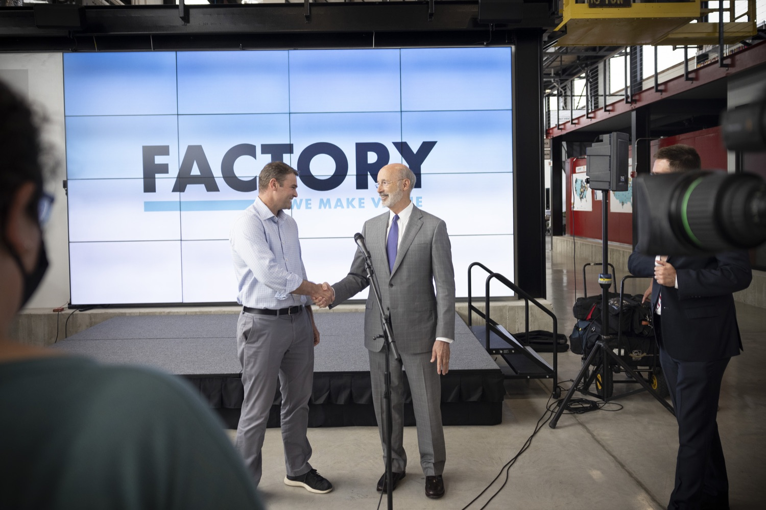 """<a href=""""https://filesource.wostreaming.net/commonwealthofpa/photo/18941_gov_economicDevelopment_dz_018.jpg"""" target=""""_blank"""">⇣Download Photo<br></a>Pennsylvania Governor Tom Wolf and Keith Caldwell, Partner  Factory LLC speaking with the press.  Governor Tom Wolf today visited Factory LLC in Bethlehem to tour the facility and highlight the importance of investing in Pennsylvanias start-up companies. During the visit, he met with companies affiliated with Factory, including Stuffed Puffs®, which received a $1 million funding proposal from the commonwealth in 2019 to expand its manufacturing operations and create jobs, Mikeys®, Pipcorn®, Honey Stinger®, and ROAR® Organic. Bethlehem, PA  July 19, 2021"""