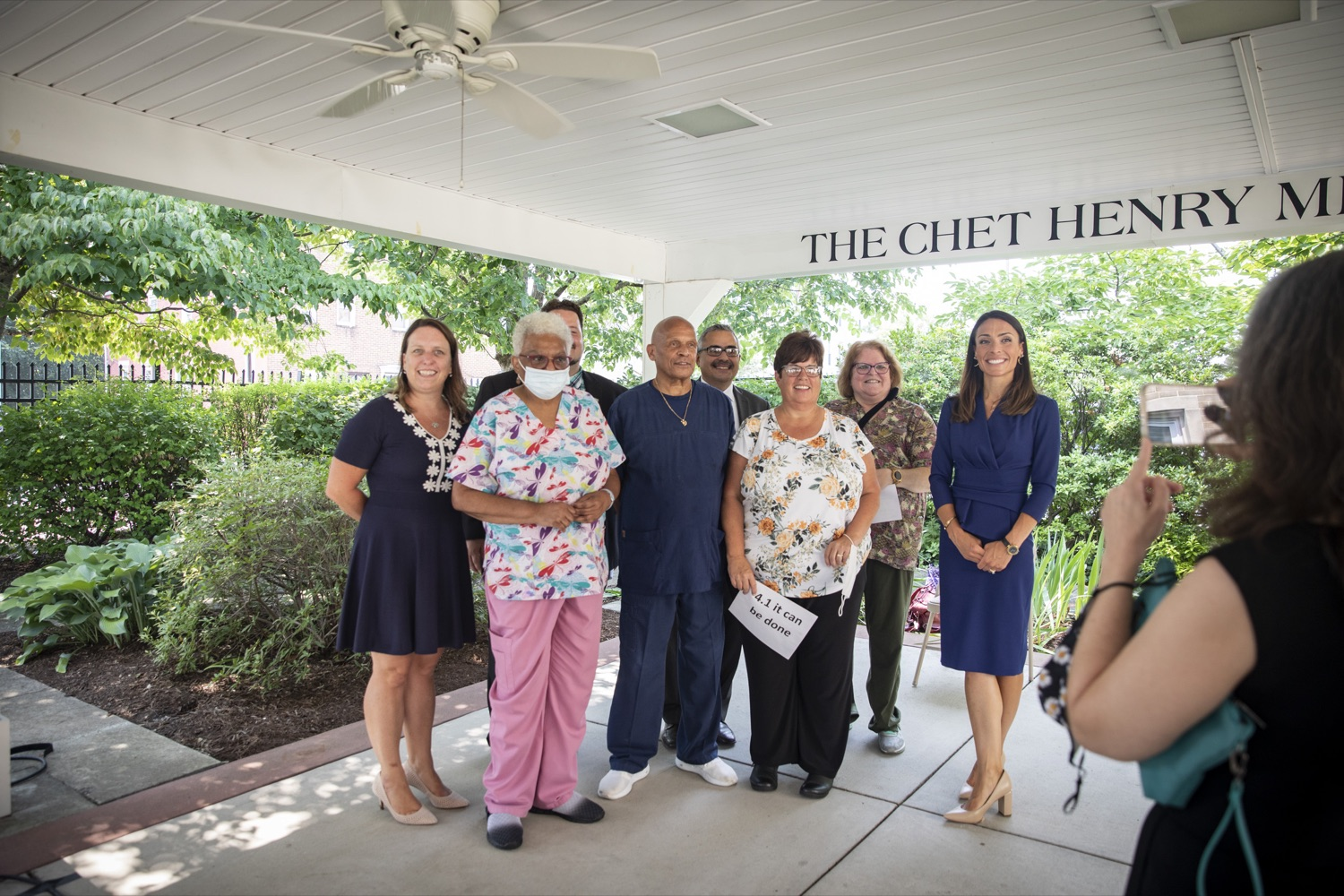 """<a href=""""https://filesource.wostreaming.net/commonwealthofpa/photo/18946_doh_LTCF_cz_08.jpg"""" target=""""_blank"""">⇣Download Photo<br></a>Acting Secretary of Health Alison Beam poses with workers from Homeland Center in Harrisburg, PA on July 21, 2021."""