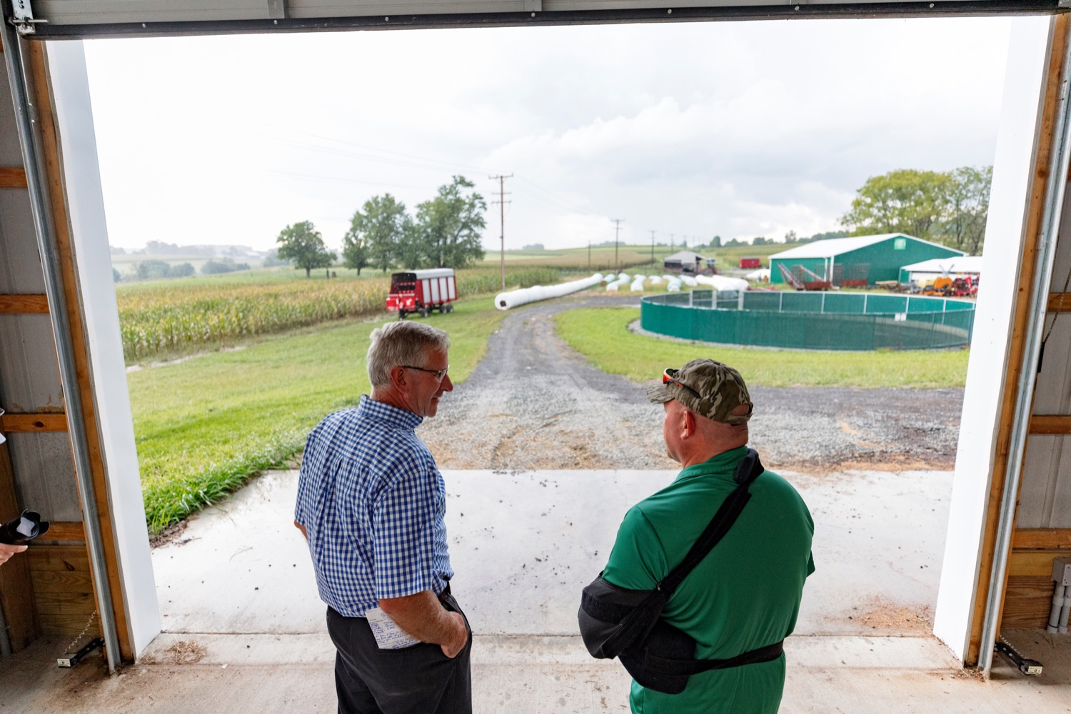 """<a href=""""https://filesource.wostreaming.net/commonwealthofpa/photo/19097_AG_DairyInnovation_NK_010.jpg"""" target=""""_blank"""">⇣Download Photo<br></a>PA Dept. of Agriculture Secretary Russell Redding talks with Todd Frye, co-owner of Pleasant Lane Farms, in Latrobe on Thursday, September 9, 2021. In 2019, Pleasant Lane Farms reconstructed their operation and on-farm business plan to safeguard the farms future for the next generation. The Frye family constructed a new barn equipped with a robotic milker, atmospheric climate control to regulate barn temperature and cow brushes to promote cow comfort. The barn directly supplies the on-farm cheese processing facility, which received a $364,082 Pennsylvania Dairy Investment Program grant to support marketing and value-added processing equipment investments. Today, the creamery at Pleasant Lane Farms processes 15,000 to 25,000 pounds of milk and produces more 1,700 to 2,900 pounds of cheese each week."""
