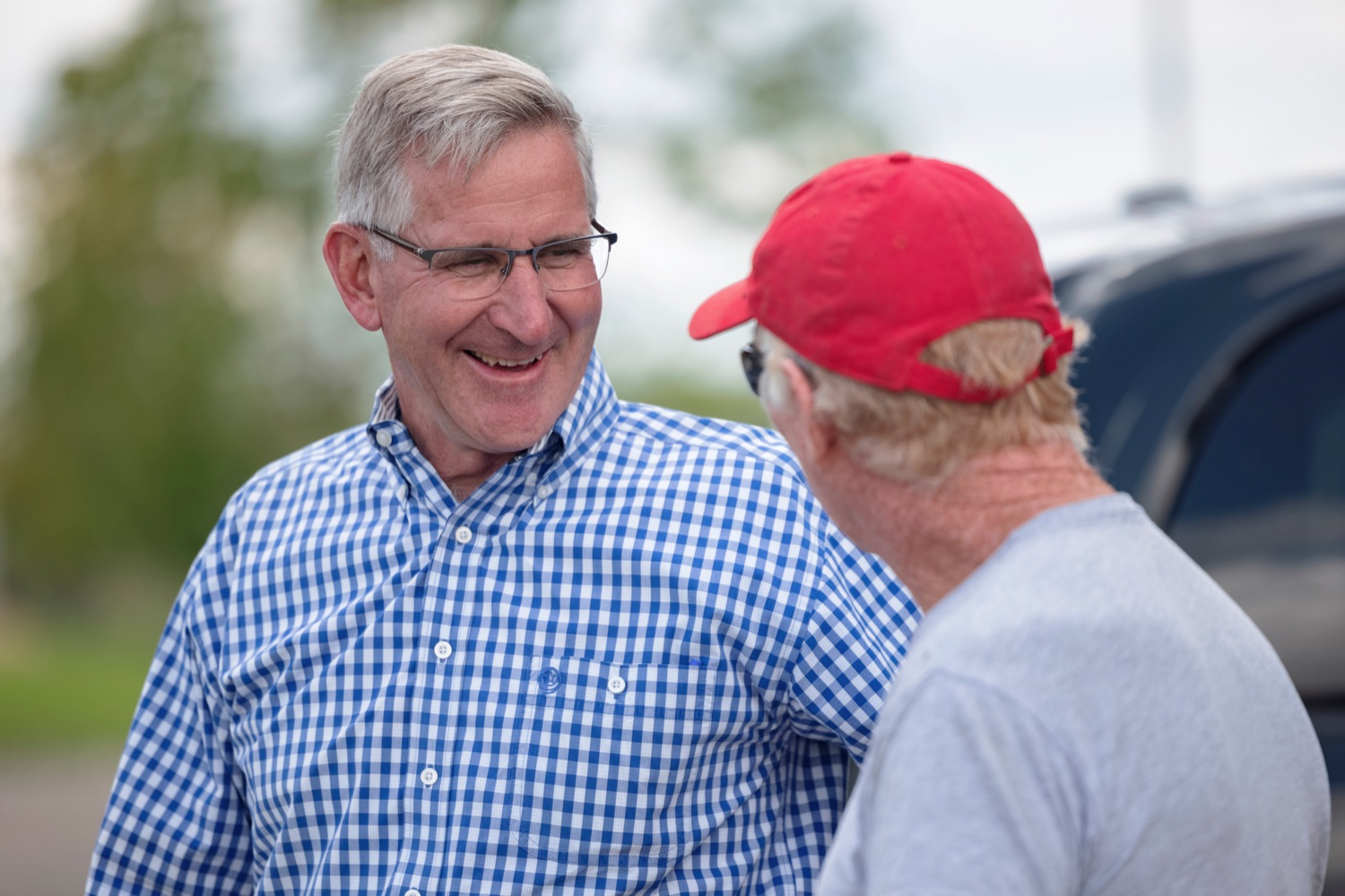 """<a href=""""https://filesource.wostreaming.net/commonwealthofpa/photo/19097_AG_DairyInnovation_NK_011.jpg"""" target=""""_blank"""">⇣Download Photo<br></a>PA Dept. of Agriculture Secretary Russell Redding talks with Ralph Frye, founder of Pleasant Lane Farms, in Latrobe on Thursday, September 9, 2021. In 2019, Pleasant Lane Farms reconstructed their operation and on-farm business plan to safeguard the farms future for the next generation. The Frye family constructed a new barn equipped with a robotic milker, atmospheric climate control to regulate barn temperature and cow brushes to promote cow comfort. The barn directly supplies the on-farm cheese processing facility, which received a $364,082 Pennsylvania Dairy Investment Program grant to support marketing and value-added processing equipment investments. Today, the creamery at Pleasant Lane Farms processes 15,000 to 25,000 pounds of milk and produces more 1,700 to 2,900 pounds of cheese each week."""