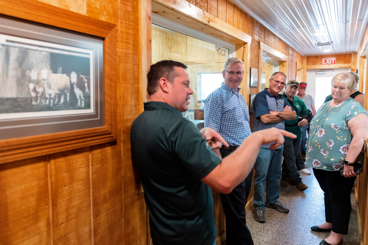 """<a href=""""https://filesource.wostreaming.net/commonwealthofpa/photo/19097_AG_DairyInnovation_NK_016.jpg"""" target=""""_blank"""">⇣Download Photo<br></a>PA Dept. of Agriculture Secretary Russell Redding gets a tour of Pleasant Lane Farms Co-Owner Jason Frye at the farm in Latrobe on Thursday, September 9, 2021. In 2019, Pleasant Lane Farms reconstructed their operation and on-farm business plan to safeguard the farms future for the next generation. The Frye family constructed a new barn equipped with a robotic milker, atmospheric climate control to regulate barn temperature and cow brushes to promote cow comfort. The barn directly supplies the on-farm cheese processing facility, which received a $364,082 Pennsylvania Dairy Investment Program grant to support marketing and value-added processing equipment investments. Today, the creamery at Pleasant Lane Farms processes 15,000 to 25,000 pounds of milk and produces more 1,700 to 2,900 pounds of cheese each week."""
