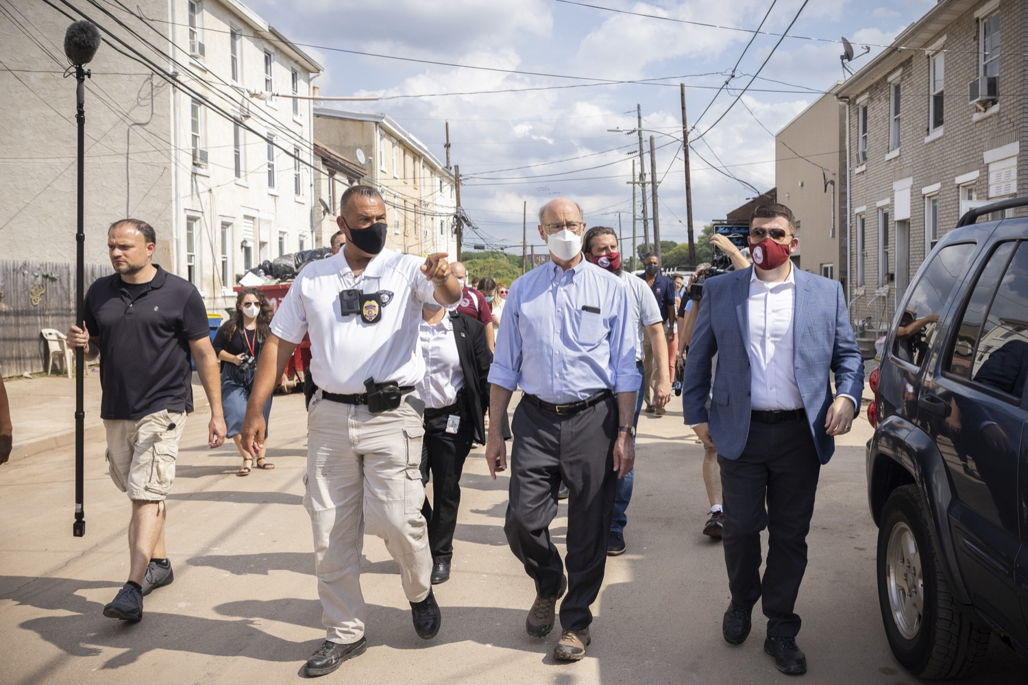 """<a href=""""https://filesource.wostreaming.net/commonwealthofpa/photo/19109_gov_stormDamage_dz_012.jpg"""" target=""""_blank"""">⇣Download Photo<br></a>Pennsylvania Governor Tom Wolf touring storm damage with Chief Todd J. Bereda,  Chief of Police, Emergency Management Coordinator Bridgeport PA.  Governor Wolf visited the Borough of Bridgeport to tour some of the areas affected by the remnants of Ida. The governor, joined by local officials, viewed and discussed the impact to damaged areas, including businesses, homes and infrastructure. Bridgeport, PA - September 08, 2021"""