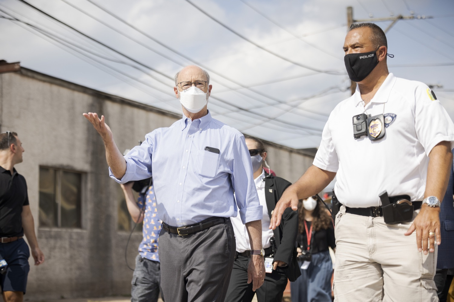 """<a href=""""https://filesource.wostreaming.net/commonwealthofpa/photo/19109_gov_stormDamage_dz_015.jpg"""" target=""""_blank"""">⇣Download Photo<br></a>Pennsylvania Governor Tom Wolf touring storm damage with Chief Todd J. Bereda,  Chief of Police, Emergency Management Coordinator Bridgeport PA.   Governor Wolf visited the Borough of Bridgeport to tour some of the areas affected by the remnants of Ida. The governor, joined by local officials, viewed and discussed the impact to damaged areas, including businesses, homes and infrastructure. Bridgeport, PA - September 08, 2021"""