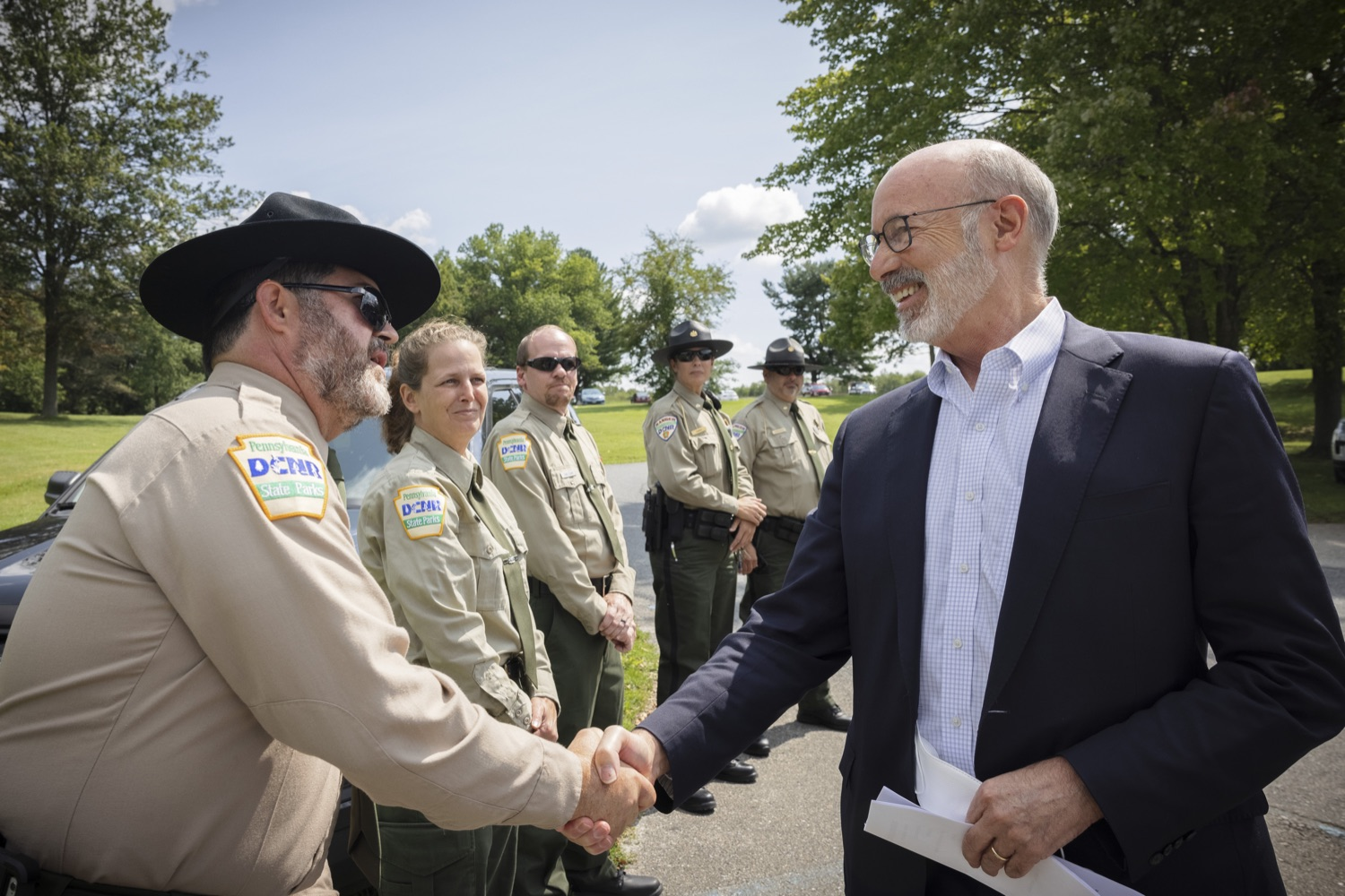"""<a href=""""https://filesource.wostreaming.net/commonwealthofpa/photo/19111_gov_parkVaccines_dz_004.jpg"""" target=""""_blank"""">⇣Download Photo<br></a>Pennsylvania Governor Tom Wolf greeting Michael Kutzmonich of the Pennsylvania DCNR.Governor Tom Wolf today announced that the Department of Health (DOH) and Department of Conservation and Natural Resources (DCNR) are partnering to hold COVID-19 vaccine clinics at five state parks across the commonwealth to help expand access to the COVID-19 vaccine.  Harrisburg, PA -- September 10, 2021"""
