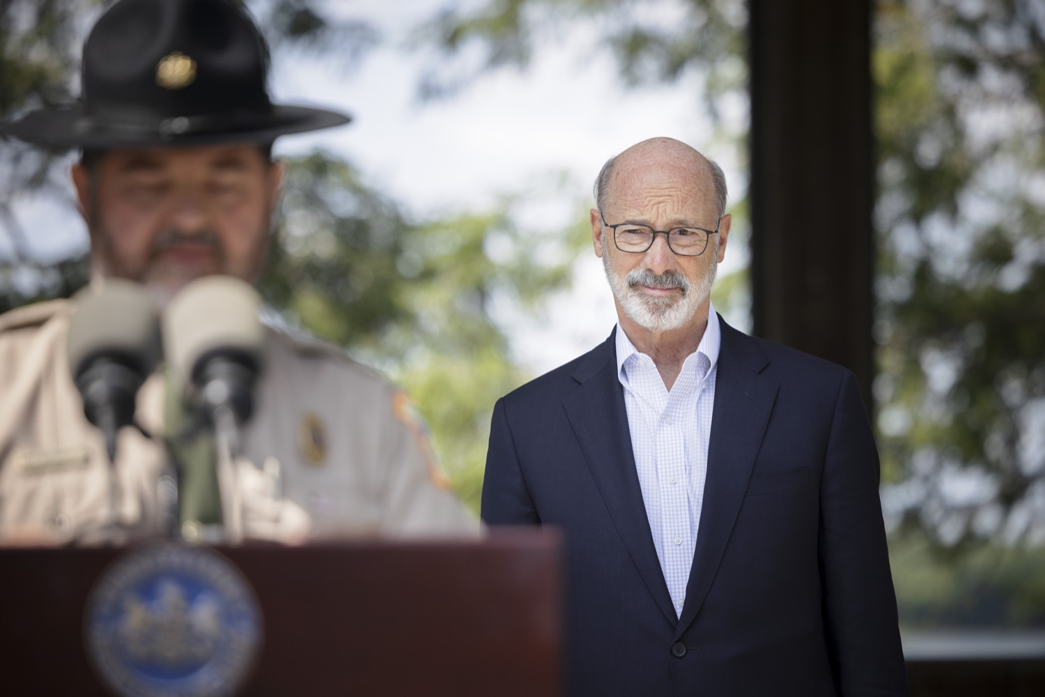"""<a href=""""https://filesource.wostreaming.net/commonwealthofpa/photo/19111_gov_parkVaccines_dz_012.jpg"""" target=""""_blank"""">⇣Download Photo<br></a>Pennsylvania Governor Tom Wolf listens as Michael Kutzmonich of the Pennsylvania DCNR speaks with the press.  Governor Tom Wolf today announced that the Department of Health (DOH) and Department of Conservation and Natural Resources (DCNR) are partnering to hold COVID-19 vaccine clinics at five state parks across the commonwealth to help expand access to the COVID-19 vaccine.  Harrisburg, PA -- September 10, 2021"""