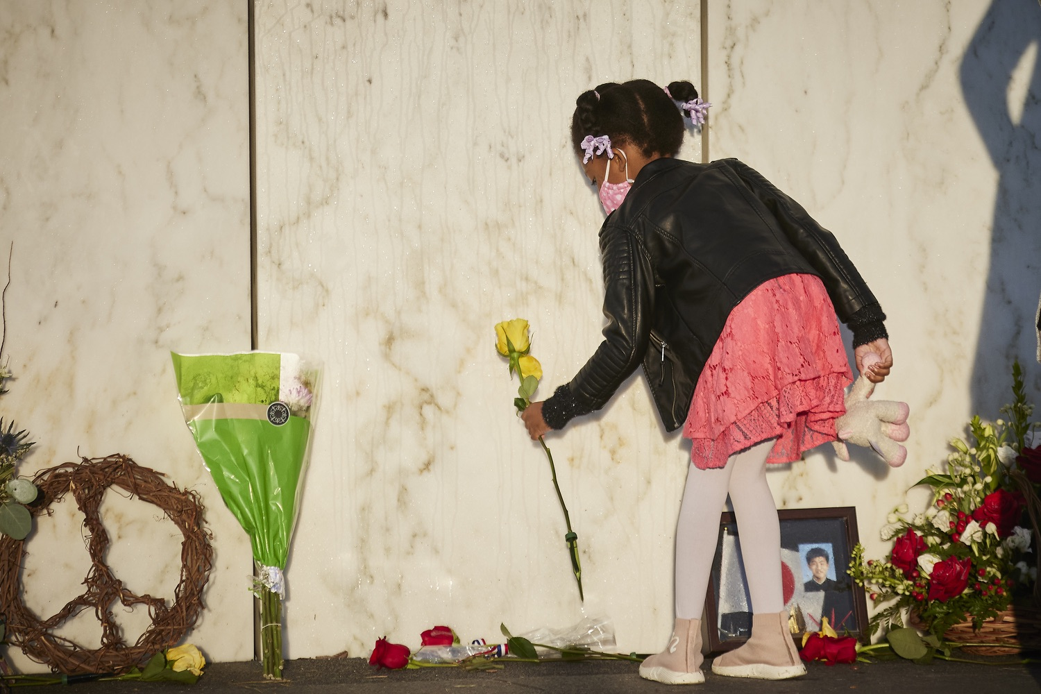 """<a href=""""https://filesource.wostreaming.net/commonwealthofpa/photo/19117_gov_Flight_93_Memorial_dz_002_copy.jpg"""" target=""""_blank"""">⇣Download Photo<br></a> A family member placing a flower along the wall of names.  Today, Governor Tom Wolf visited the Flight 93 National Memorial for the 20th annual September 11 observance. Gov. Wolf joined families and guests to honor the passengers and crew of Flight 93. Flight 93 National Memorial, Shanksville, PA - September 11, 2021"""
