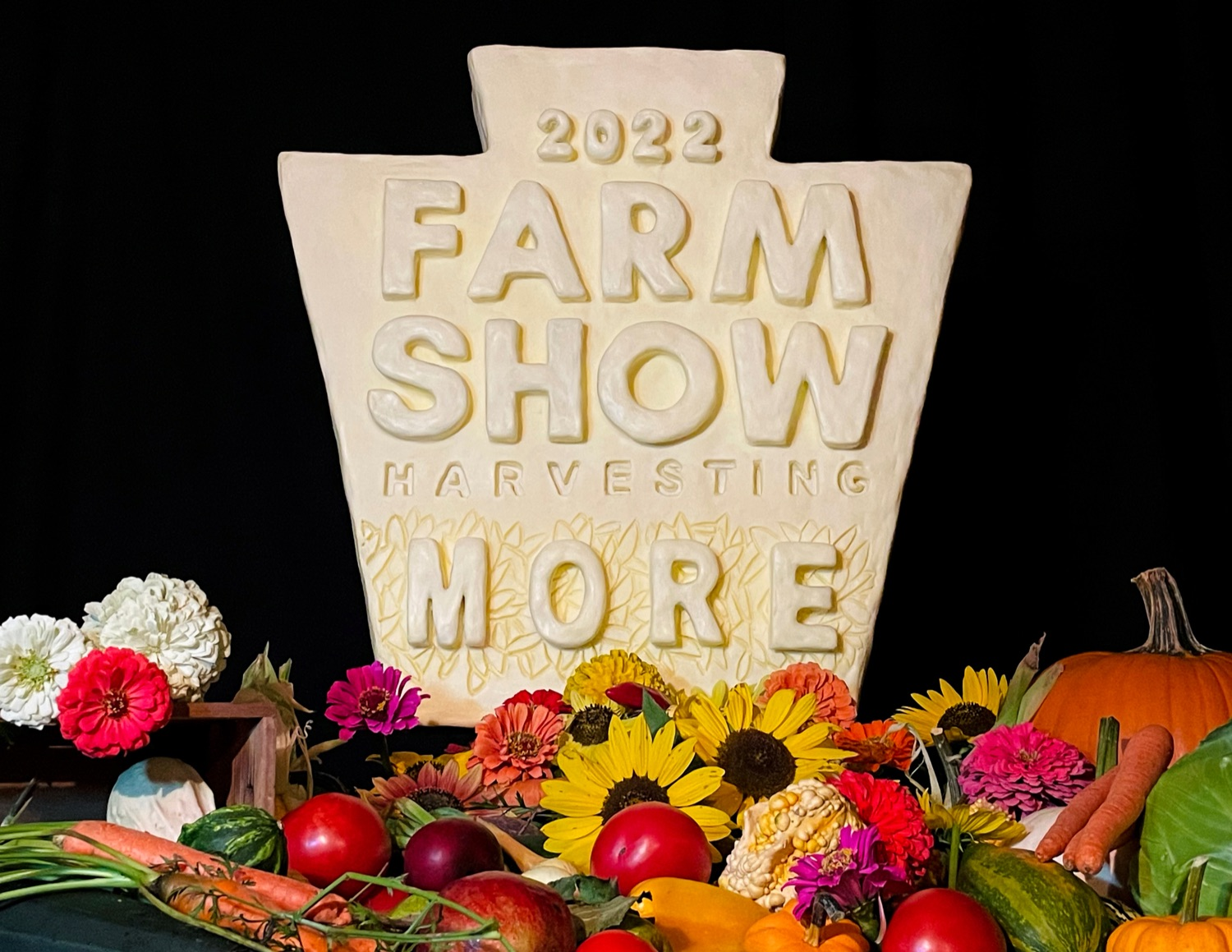 """<a href=""""https://filesource.wostreaming.net/commonwealthofpa/photo/19118_AG_FarmShowTheme_NK_005.jpg"""" target=""""_blank"""">⇣Download Photo<br></a>A 20-pound mini butter sculpture of the 2022 Harvesting More logo, sculpted by PA Garret McCall, winner of the 2021 Butter Up! competition held during the virtual 2021 PA Farm Show, is pictured at Vale Wood Farms in Loretto on Thursday, September 16, 2021."""