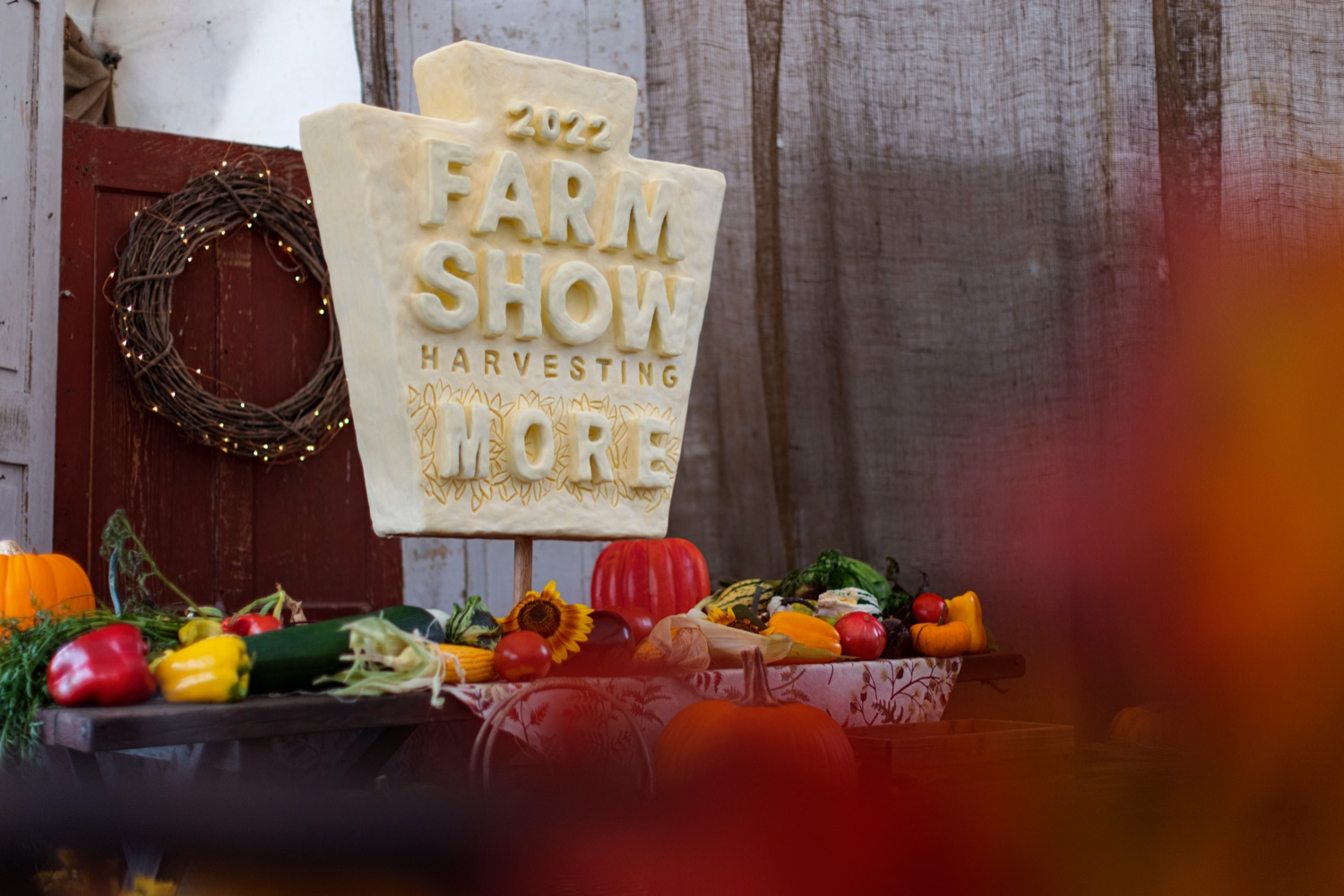 """<a href=""""https://filesource.wostreaming.net/commonwealthofpa/photo/19118_AG_FarmShowTheme_NK_013.jpg"""" target=""""_blank"""">⇣Download Photo<br></a>A 20-pound mini butter sculpture of the 2022 Harvesting More logo, sculpted by PA Garret McCall, winner of the 2021 Butter Up! competition held during the virtual 2021 PA Farm Show, is pictured at Vale Wood Farms in Loretto on Thursday, September 16, 2021."""