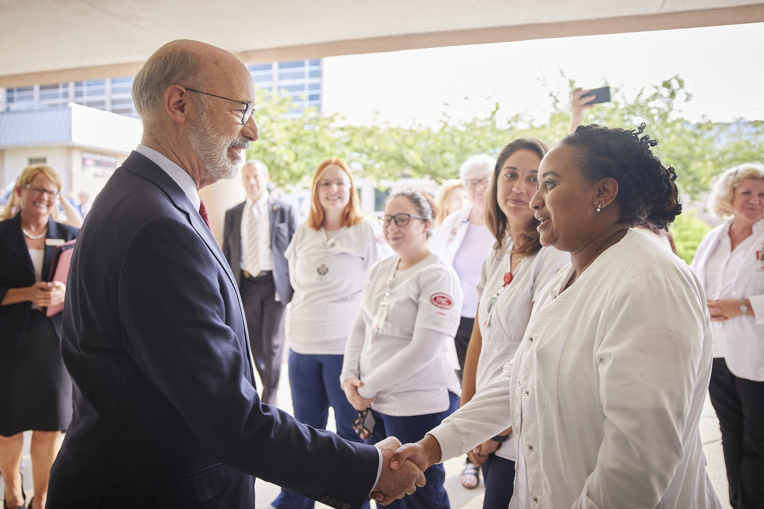 """<a href=""""https://filesource.wostreaming.net/commonwealthofpa/photo/19120_gov_vaccines_dz_009.jpg"""" target=""""_blank"""">⇣Download Photo<br></a>Pennsylvania Governor Tom Wolf greeting students.  Governor Tom Wolf, state leaders, and community partners visited a local vaccine clinic to encourage eligible Pennsylvanians to do their part to end the COVID-19 pandemic by getting vaccinated.   Reading, PA - September 14, 2021"""