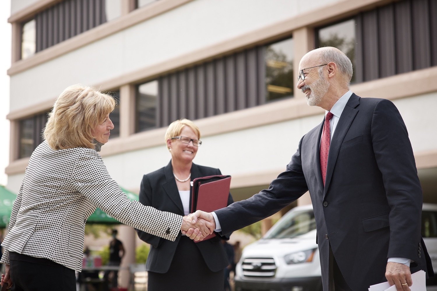 """<a href=""""https://filesource.wostreaming.net/commonwealthofpa/photo/19120_gov_vaccines_dz_019.jpg"""" target=""""_blank"""">⇣Download Photo<br></a>Pennsylvania Governor Tom Wolf greeting Senator Judy Schwank.  Governor Tom Wolf, state leaders, and community partners visited a local vaccine clinic to encourage eligible Pennsylvanians to do their part to end the COVID-19 pandemic by getting vaccinated.   Reading, PA - September 14, 2021"""