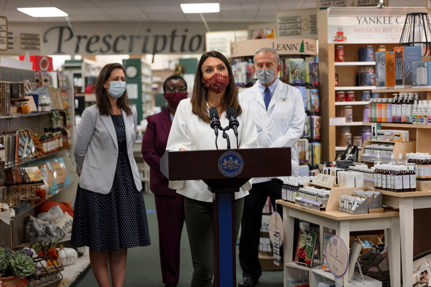 """<a href=""""https://filesource.wostreaming.net/commonwealthofpa/photo/19144_DOH_BoosterShots_NK_009.jpg"""" target=""""_blank"""">⇣Download Photo<br></a>Acting Secretary of Health Alison Beam speaks during a press conference, which discussed an order to ensure that vaccine providers are prepared to start COVID-19 booster shots as soon as the Centers for Disease Control and Prevention (CDC) issues the necessary federal guidance, in Hershey Pharmacy in Hershey on Tuesday, September 21, 2021. Pennsylvania is well prepared to start providing vaccine booster shots just as soon as the CDC provides the approval and guidelines on who can get it, Beam said. Vaccine providers  especially pharmacies  have already done a tremendous job administering more than 12 million vaccines across the state. Now they are ready to get booster shots to people as quickly and efficiently as possible."""