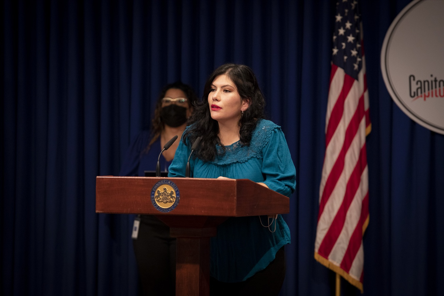 """<a href=""""https://filesource.wostreaming.net/commonwealthofpa/photo/20059_dhs_rentalAssistance_cz_09.jpg"""" target=""""_blank"""">⇣Download Photo<br></a>Maria Alejandra Hernandez, Coordinator at Movement of Immigrant Leaders in Pennsylvania, promotes the Emergency Rental Assistance Program in Spanish to non-English-speaking and immigrant communities, at the Harrisburg Capitol on September 16, 2021."""