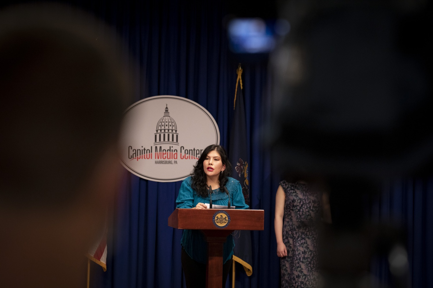 """<a href=""""https://filesource.wostreaming.net/commonwealthofpa/photo/20059_dhs_rentalAssistance_cz_10.jpg"""" target=""""_blank"""">⇣Download Photo<br></a>Maria Alejandra Hernandez, Coordinator at Movement of Immigrant Leaders in Pennsylvania, promotes the Emergency Rental Assistance Program in Spanish to non-English-speaking and immigrant communities, at the Harrisburg Capitol on September 16, 2021."""