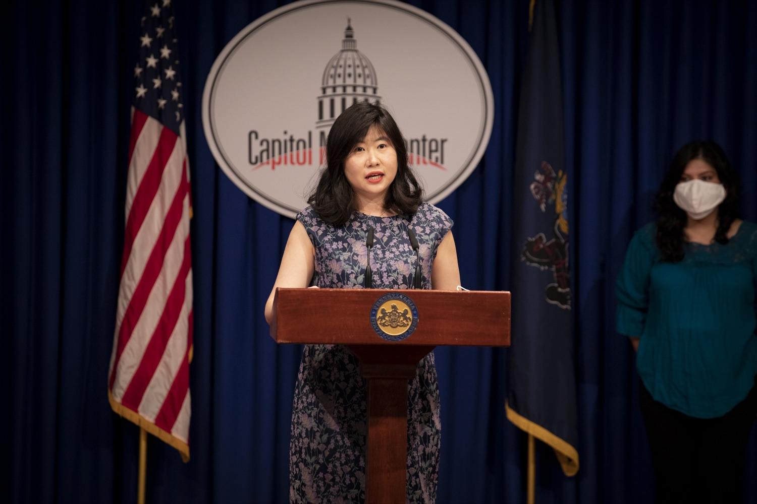 """<a href=""""https://filesource.wostreaming.net/commonwealthofpa/photo/20059_dhs_rentalAssistance_cz_11.jpg"""" target=""""_blank"""">⇣Download Photo<br></a>Stephanie Sun, Executive Director of the Pennsylvania Commission on Asian Pacific American Affairs, promotes the Emergency Rental Assistance Program in Mandarin to non-English-speaking and immigrant communities, at the Harrisburg Capitol on September 16, 2021."""
