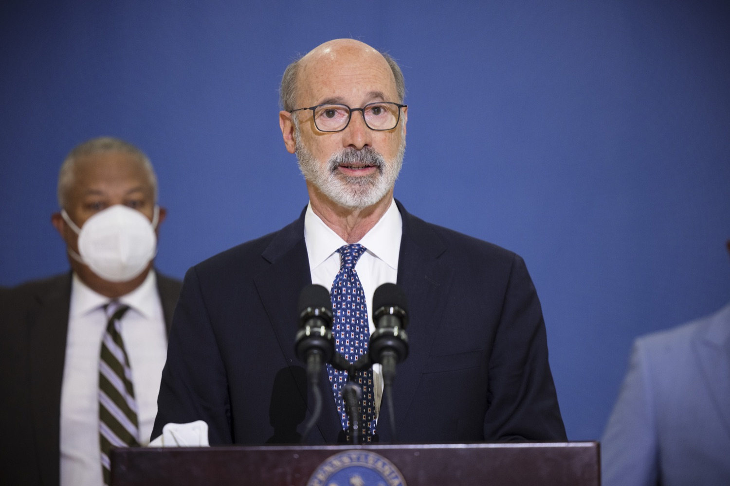 """<a href=""""https://filesource.wostreaming.net/commonwealthofpa/photo/20078_gov_gunviolence_dz_016.jpg"""" target=""""_blank"""">⇣Download Photo<br></a>Pennsylvania Governor Tom Wolf speaking with the press.  Governor Tom Wolf today joined state lawmakers to remind communities and organizations that $24 million in state funding is available to address community violence.  Philadelphia, PA - September 23, 2021"""