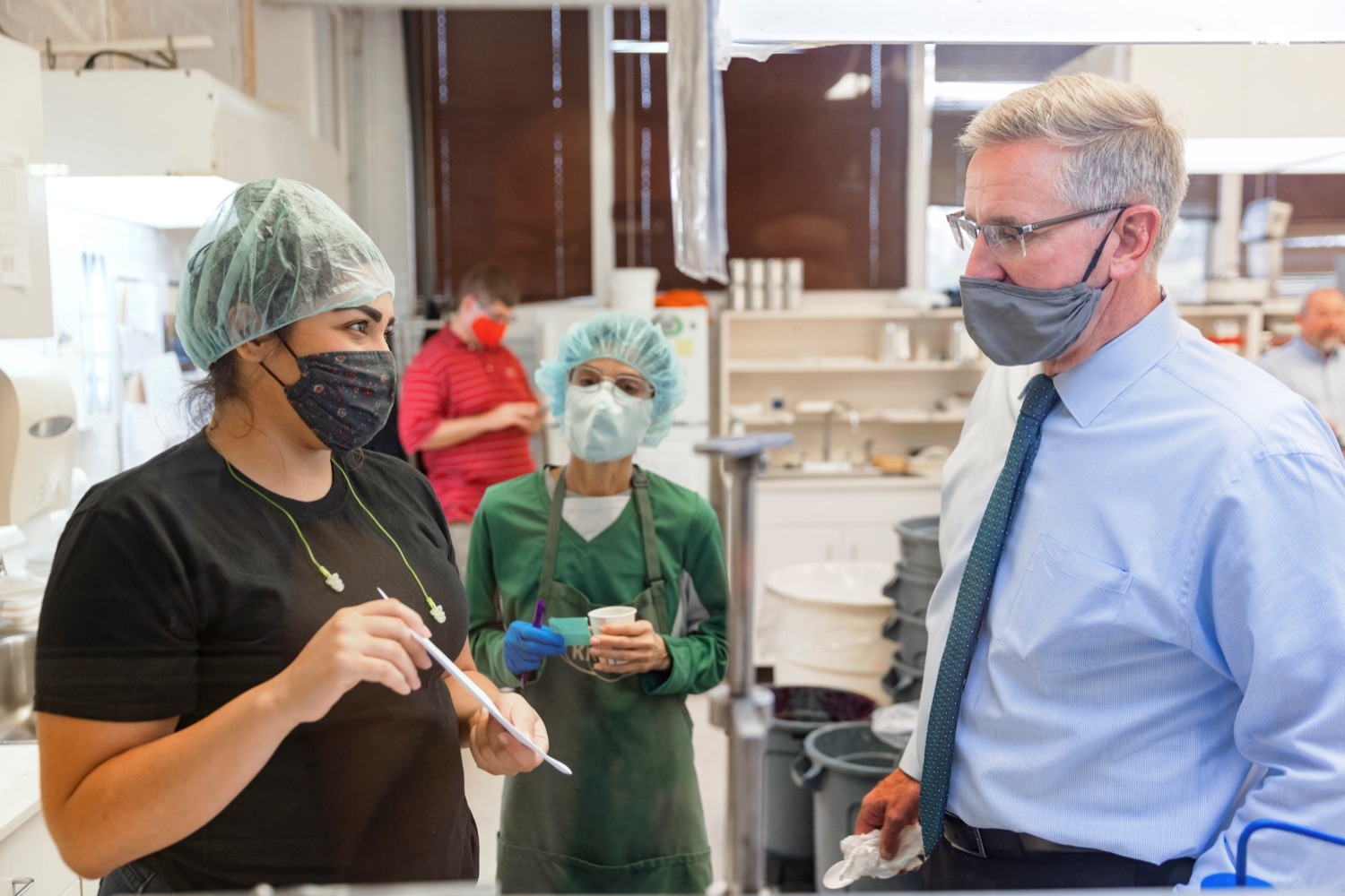 """<a href=""""https://filesource.wostreaming.net/commonwealthofpa/photo/20111_AGRIC_Food_Fuels_NK_003.JPG"""" target=""""_blank"""">⇣Download Photo<br></a>Agriculture Secretary Russell Redding talks with Knouse Foods laboratory technicians Samantha Valdez, left, and Becky Canard, center, during a press conference, which highlighted Pennsylvanias agriculture and food manufacturing industry at Knouse Foods, kicking off the Food that Fuels Pennsylvania tour, a plan to spotlight the commonwealths agriculture and food manufacturing industry and its workforce, on Wednesday, October 13, 2021."""