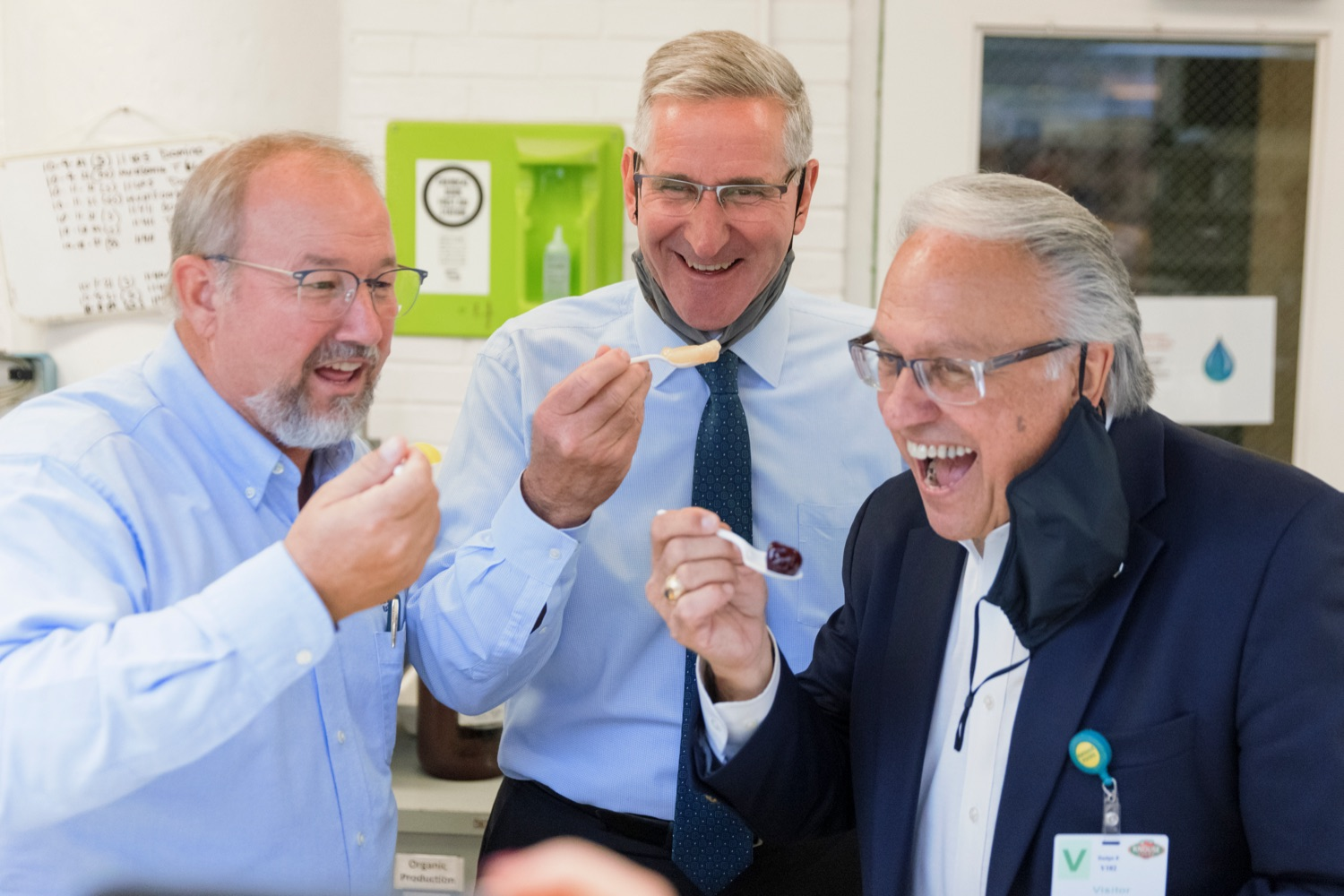 """<a href=""""https://filesource.wostreaming.net/commonwealthofpa/photo/20111_AGRIC_Food_Fuels_NK_011.JPG"""" target=""""_blank"""">⇣Download Photo<br></a>Agriculture Secretary Russell Redding, center, taste tests fruit with representatives Dan Moul, left, and Eddie Day Pashinski, right, during a press conference, which highlighted Pennsylvanias agriculture and food manufacturing industry at Knouse Foods, kicking off the Food that Fuels Pennsylvania tour, a plan to spotlight the commonwealths agriculture and food manufacturing industry and its workforce, on Wednesday, October 13, 2021."""