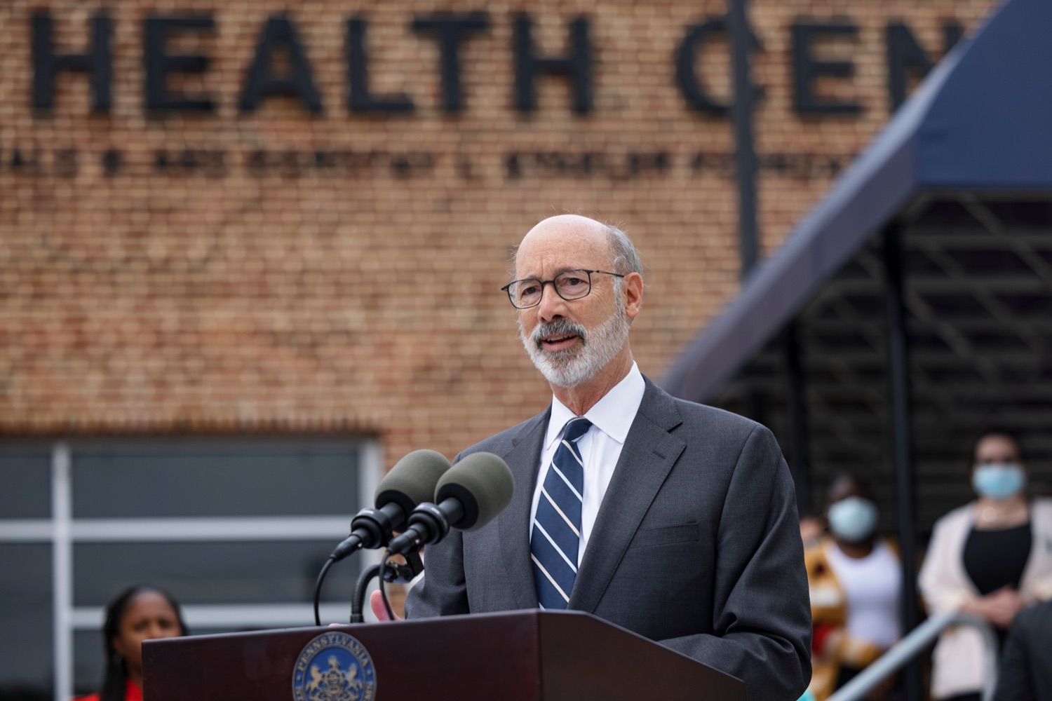"""<a href=""""https://filesource.wostreaming.net/commonwealthofpa/photo/20119_GOV_Vaccines_NK_001.jpg"""" target=""""_blank"""">⇣Download Photo<br></a>PA Governor Tom Wolf speaks during a press conference, which encouraged eligible Pennsylvanians who are not yet vaccinated to take advantage of their upcoming community COVID-19 vaccine clinic in partnership with the Zeta Theta Lambda Chapter of Alpha Phi Alpha fraternity, outside Hamilton Health Center in Harrisburg on Wednesday, October 6, 2021. The clinic will run on Saturday, October 9, COVID-19 vaccinations will be offered from 10am  2pm at Hamilton Health Center, 100 S. 17th St., Harrisburg, PA 17104."""