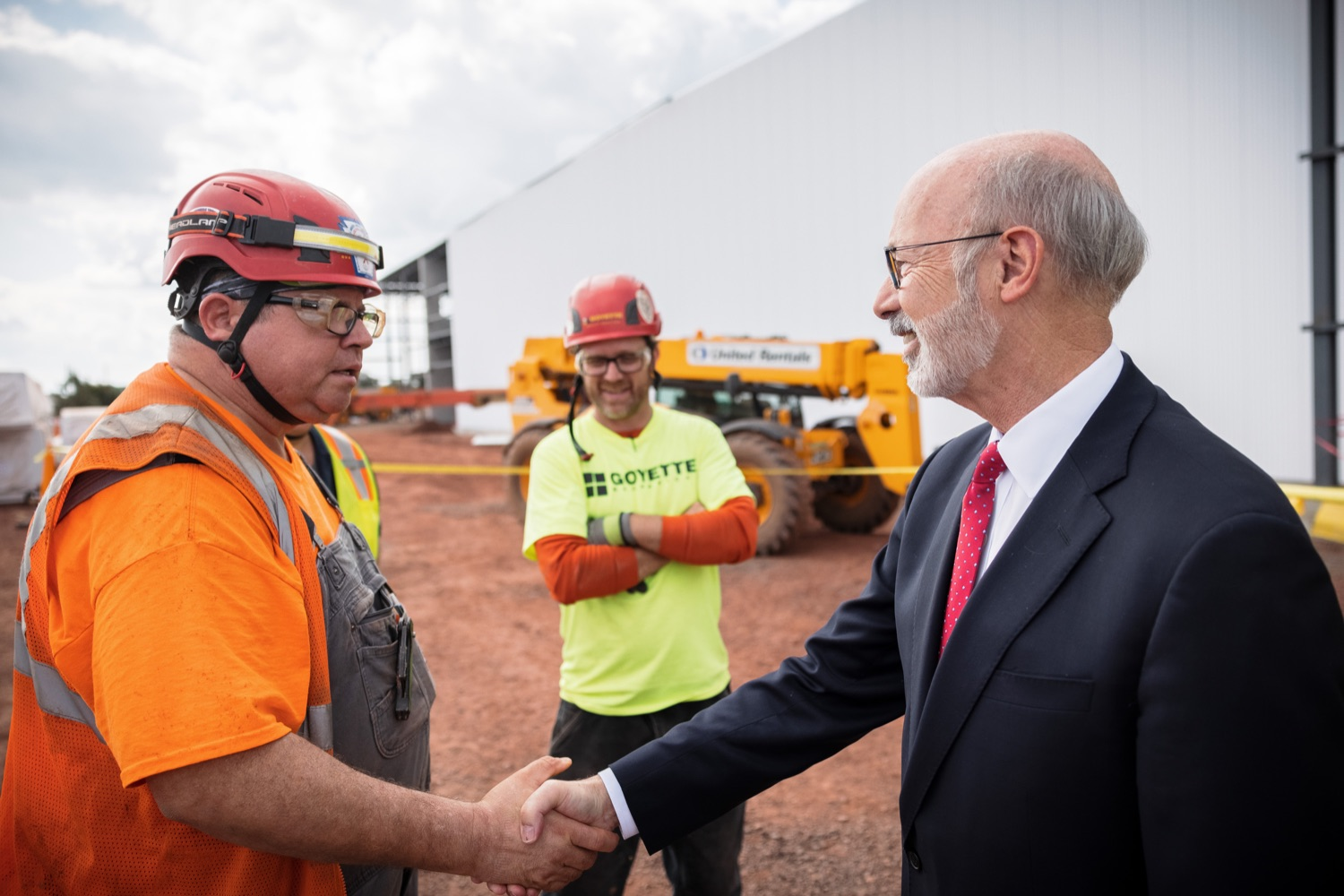 """<a href=""""https://filesource.wostreaming.net/commonwealthofpa/photo/20126_gov_economicDevelopment_dz_001.jpg"""" target=""""_blank"""">⇣Download Photo<br></a>Pennsylvania Governor Tom Wolf greeting construction workers as he tours the site.  Governor Tom Wolf joined Clemens Food Group leaders, Agriculture Secretary Russell Redding, Sen. Maria Collett, Rep. Steve Malagari and members of the Governors Action Team today to tour the construction of the companys new facility in Montgomery County. The Wolf Administration supported the project which will expand the business operations and create new jobs in the region. Hatfield, PA   October 8, 2021"""