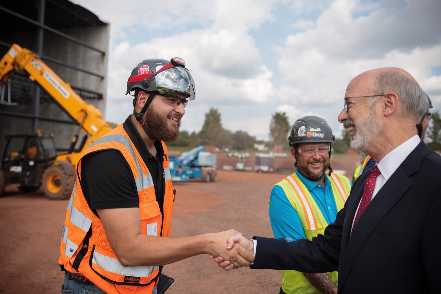 """<a href=""""https://filesource.wostreaming.net/commonwealthofpa/photo/20126_gov_economicDevelopment_dz_004.jpg"""" target=""""_blank"""">⇣Download Photo<br></a>Pennsylvania Governor Tom Wolf greeting construction workers as he tours the site.  Governor Tom Wolf joined Clemens Food Group leaders, Agriculture Secretary Russell Redding, Sen. Maria Collett, Rep. Steve Malagari and members of the Governors Action Team today to tour the construction of the companys new facility in Montgomery County. The Wolf Administration supported the project which will expand the business operations and create new jobs in the region. Hatfield, PA   October 8, 2021"""