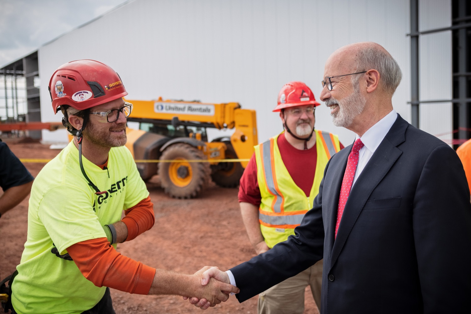"""<a href=""""https://filesource.wostreaming.net/commonwealthofpa/photo/20126_gov_economicDevelopment_dz_009.jpg"""" target=""""_blank"""">⇣Download Photo<br></a>Pennsylvania Governor Tom Wolf greeting construction workers as he tours the site.  Governor Tom Wolf joined Clemens Food Group leaders, Agriculture Secretary Russell Redding, Sen. Maria Collett, Rep. Steve Malagari and members of the Governors Action Team today to tour the construction of the companys new facility in Montgomery County. The Wolf Administration supported the project which will expand the business operations and create new jobs in the region. Hatfield, PA   October 8, 2021"""