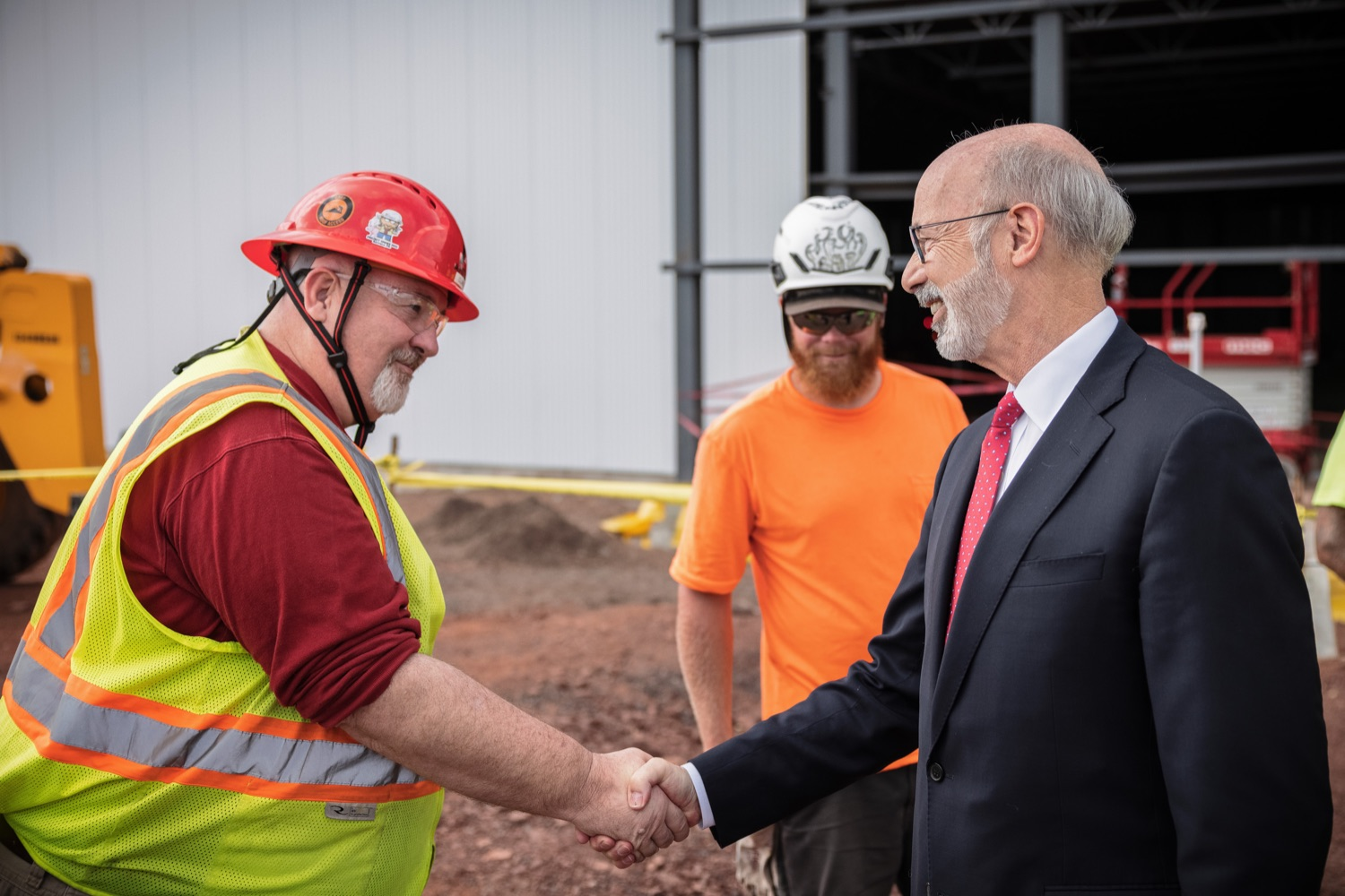 """<a href=""""https://filesource.wostreaming.net/commonwealthofpa/photo/20126_gov_economicDevelopment_dz_011.jpg"""" target=""""_blank"""">⇣Download Photo<br></a>Pennsylvania Governor Tom Wolf greeting construction workers as he tours the site.  Governor Tom Wolf joined Clemens Food Group leaders, Agriculture Secretary Russell Redding, Sen. Maria Collett, Rep. Steve Malagari and members of the Governors Action Team today to tour the construction of the companys new facility in Montgomery County. The Wolf Administration supported the project which will expand the business operations and create new jobs in the region. Hatfield, PA   October 8, 2021"""