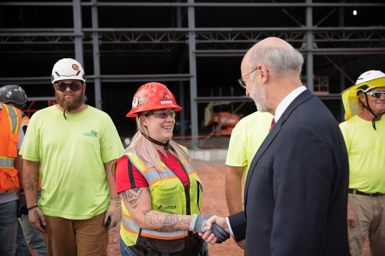 """<a href=""""https://filesource.wostreaming.net/commonwealthofpa/photo/20126_gov_economicDevelopment_dz_014.jpg"""" target=""""_blank"""">⇣Download Photo<br></a>Pennsylvania Governor Tom Wolf greeting construction workers as he tours the site.  Governor Tom Wolf joined Clemens Food Group leaders, Agriculture Secretary Russell Redding, Sen. Maria Collett, Rep. Steve Malagari and members of the Governors Action Team today to tour the construction of the companys new facility in Montgomery County. The Wolf Administration supported the project which will expand the business operations and create new jobs in the region. Hatfield, PA   October 8, 2021"""