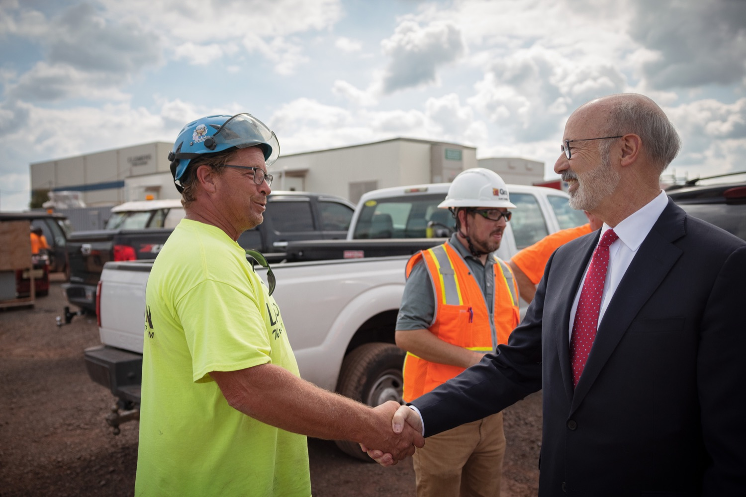 """<a href=""""https://filesource.wostreaming.net/commonwealthofpa/photo/20126_gov_economicDevelopment_dz_023.jpg"""" target=""""_blank"""">⇣Download Photo<br></a>Pennsylvania Governor Tom Wolf greeting construction workers as he tours the site.  Governor Tom Wolf joined Clemens Food Group leaders, Agriculture Secretary Russell Redding, Sen. Maria Collett, Rep. Steve Malagari and members of the Governors Action Team today to tour the construction of the companys new facility in Montgomery County. The Wolf Administration supported the project which will expand the business operations and create new jobs in the region. Hatfield, PA   October 8, 2021"""