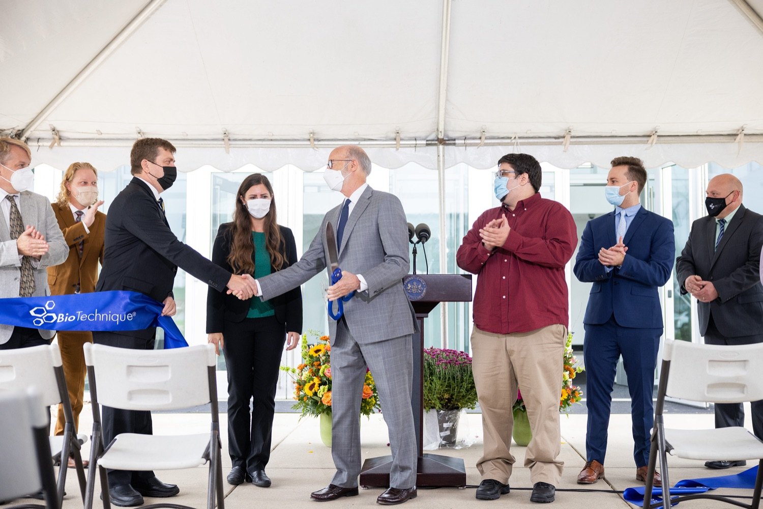 """<a href=""""https://filesource.wostreaming.net/commonwealthofpa/photo/20138_gov_BioTechniqueRibbon_dz_018.JPG"""" target=""""_blank"""">⇣Download Photo<br></a>Pennsylvania Governor Tom Wolf congratulating John Clapham, CEO, PSC Biotech Corporation & BioTechnique. Governor Tom Wolf today joined BioTechnique CEO John Clapham, the Department of Community and Economic Developments (DCED) Governors Action Team (GAT), York County Economic Alliance CEO Kevin Schreiber, and local officials at the ribbon cutting ceremony for BioTechniques new pharmaceutical manufacturing facility in York County.   OCTOBER 12, 2021 - YORK, PA"""