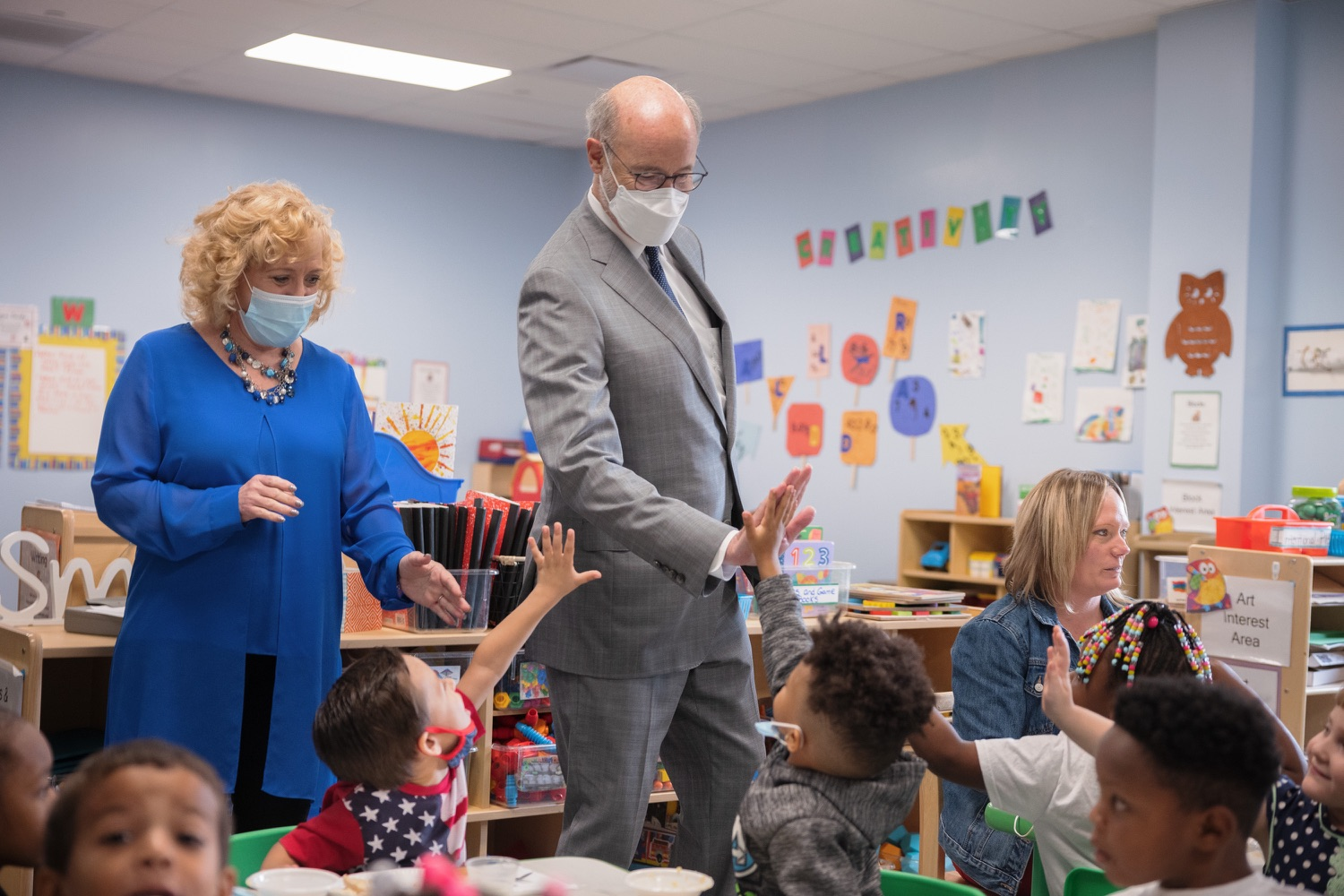 """<a href=""""https://filesource.wostreaming.net/commonwealthofpa/photo/20139_gov_childcare_dz_023.jpg"""" target=""""_blank"""">⇣Download Photo<br></a>Pennsylvania Governor Tom Wolf and Rina Irwin, CEO, Child Development Centers taking a tour of the Gilson Child Development Center.  Governor Tom Wolf today visited Gilson Child Development Center in Erie to celebrate the $30 million increase in state funding to expand early childhood learning to more than 3,200 additional young children and the $655 million available in federal funding to stabilize childcare providers during the pandemic.  Erie, PA  October 12, 2021"""