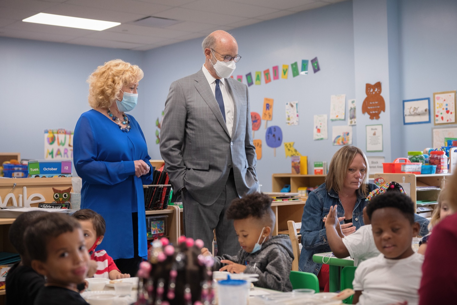"""<a href=""""https://filesource.wostreaming.net/commonwealthofpa/photo/20139_gov_childcare_dz_031.jpg"""" target=""""_blank"""">⇣Download Photo<br></a>Pennsylvania Governor Tom Wolf and Rina Irwin, CEO, Child Development Centers taking a tour of the Gilson Child Development Center.  Governor Tom Wolf today visited Gilson Child Development Center in Erie to celebrate the $30 million increase in state funding to expand early childhood learning to more than 3,200 additional young children and the $655 million available in federal funding to stabilize childcare providers during the pandemic.  Erie, PA  October 12, 2021"""